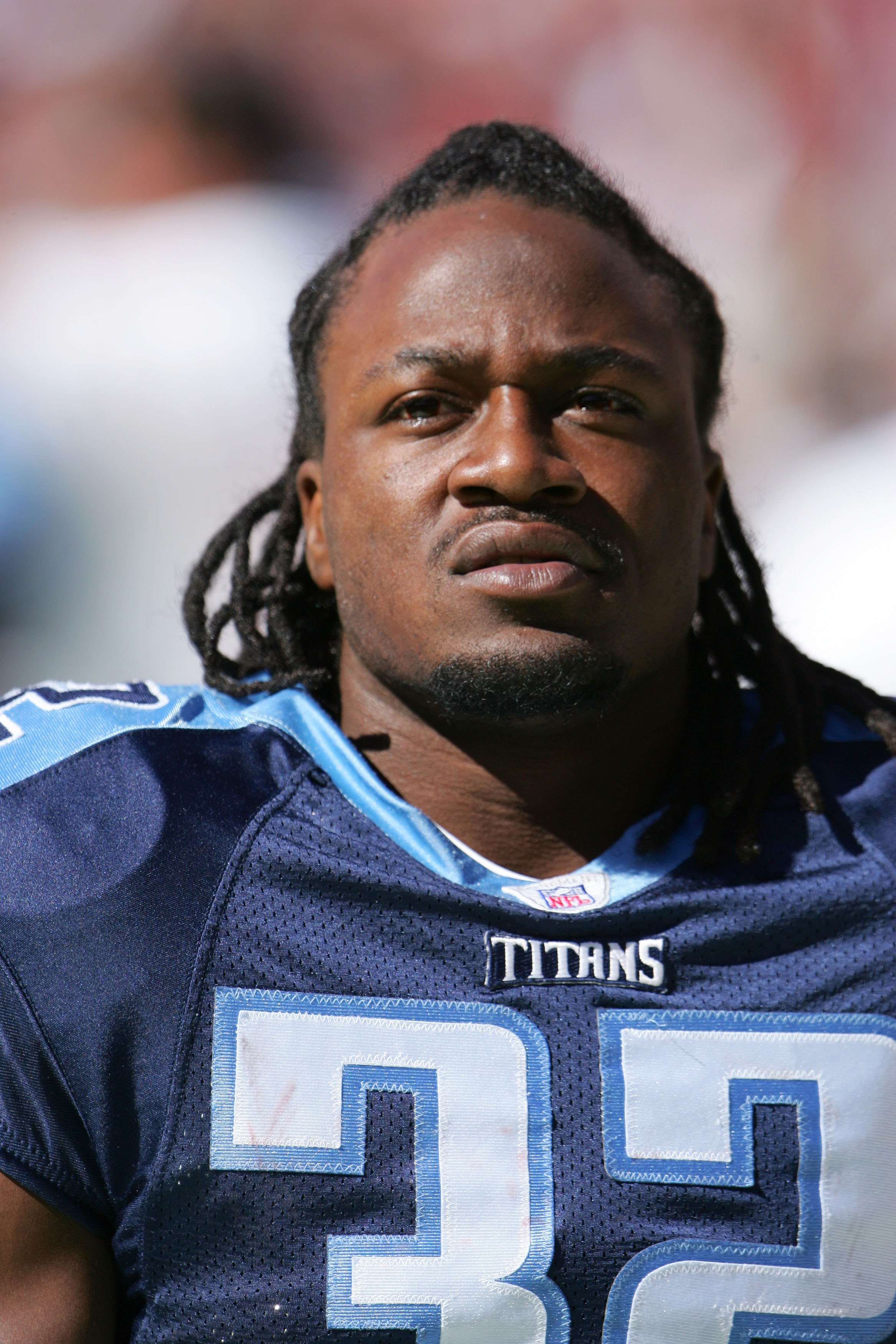 WASHINGTON ? OCTOBER 15:  Cornerback Pacman Jones #32 of the Tennessee Titans watches the game against the Washington Redskins on October 15, 2006 at FedExField in Landover, Maryland. The Titans won 25-22.  (Photo by Chris McGrath/Getty Images)