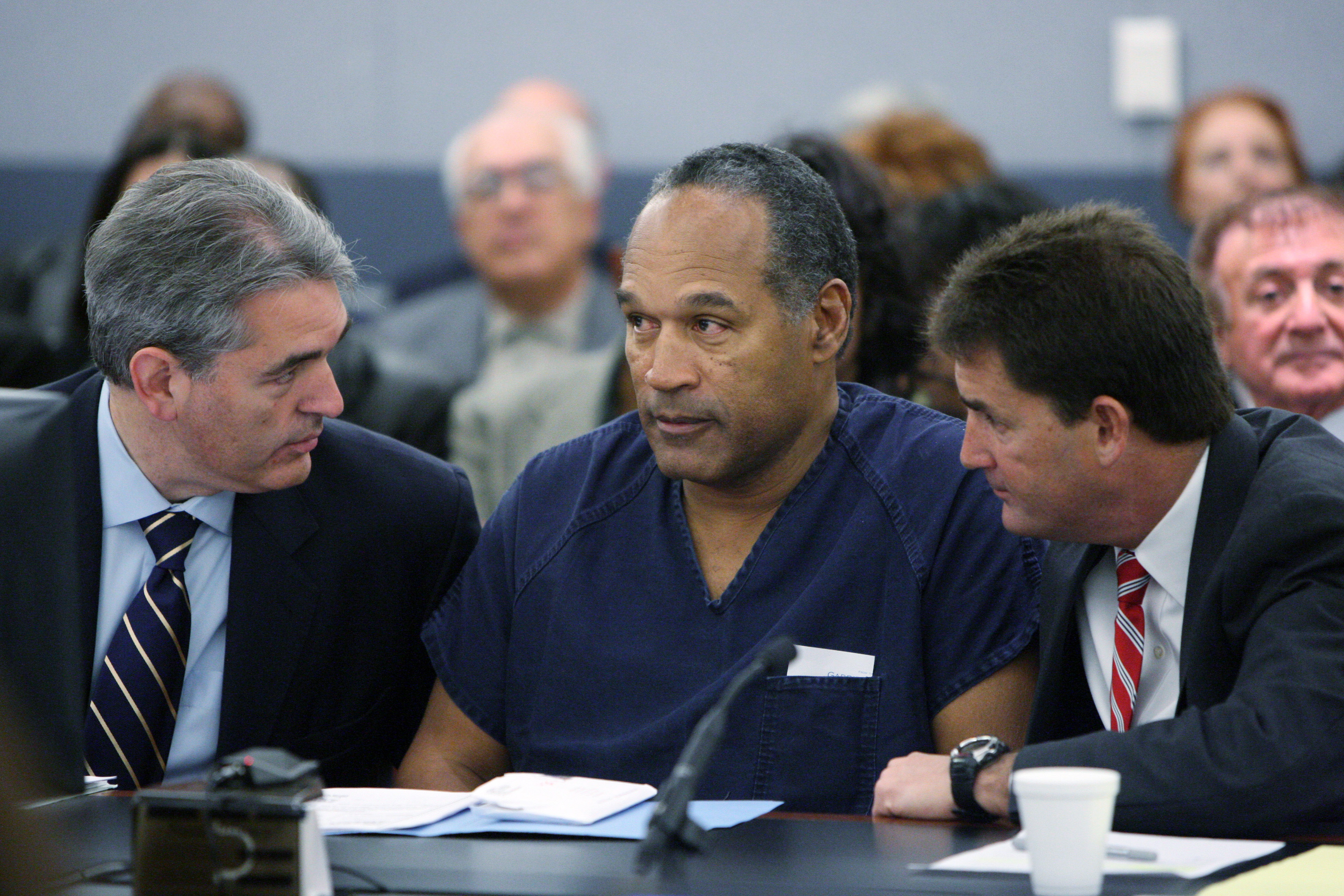 LAS VEGAS - DECEMBER 5:  O.J. Simpson (C) appears in court with attorneys Gabriel Grasso (L) and Yale Galanter prior to sentencing at the Clark County Regional Justice Center December 5, 2008 in Las Vegas, Nevada.  Simpson and co-defendant Clarence 'C.J.'