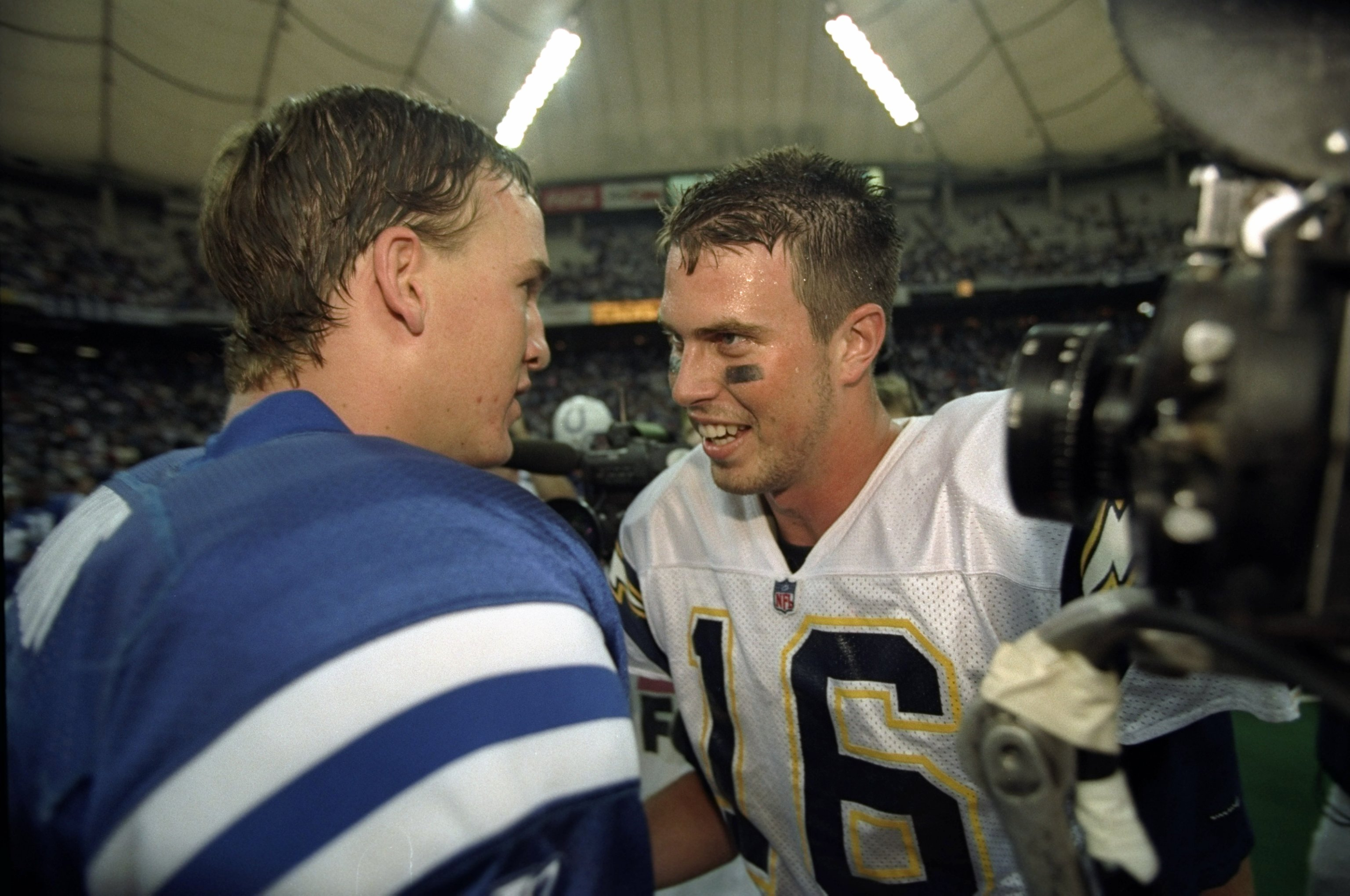 4 Oct 1998:  Quarterback Ryan Leaf #16 of the San Diego Chargers greets quarterback Peyton Manning #18 of the Indianapolis Colts following a game at the RCA Dome in Indianapolis, Indiana. The Colts defeated the Chargers 17-12. Mandatory Credit: Vincent La