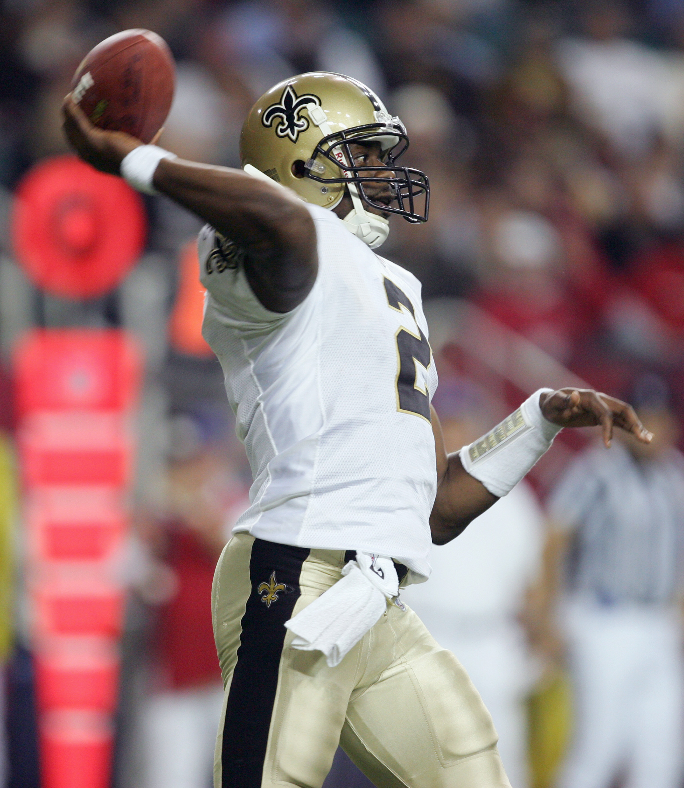 ATLANTA - DECEMBER 12:  Quarterback Aaron Brooks #2 of the New Orleans Saints passes the ball during the game against the Atlanta Falcons on December 12, 2005 at the Georgia Dome in Atlanta, Georgia.  (Photo By Streeter Lecka)