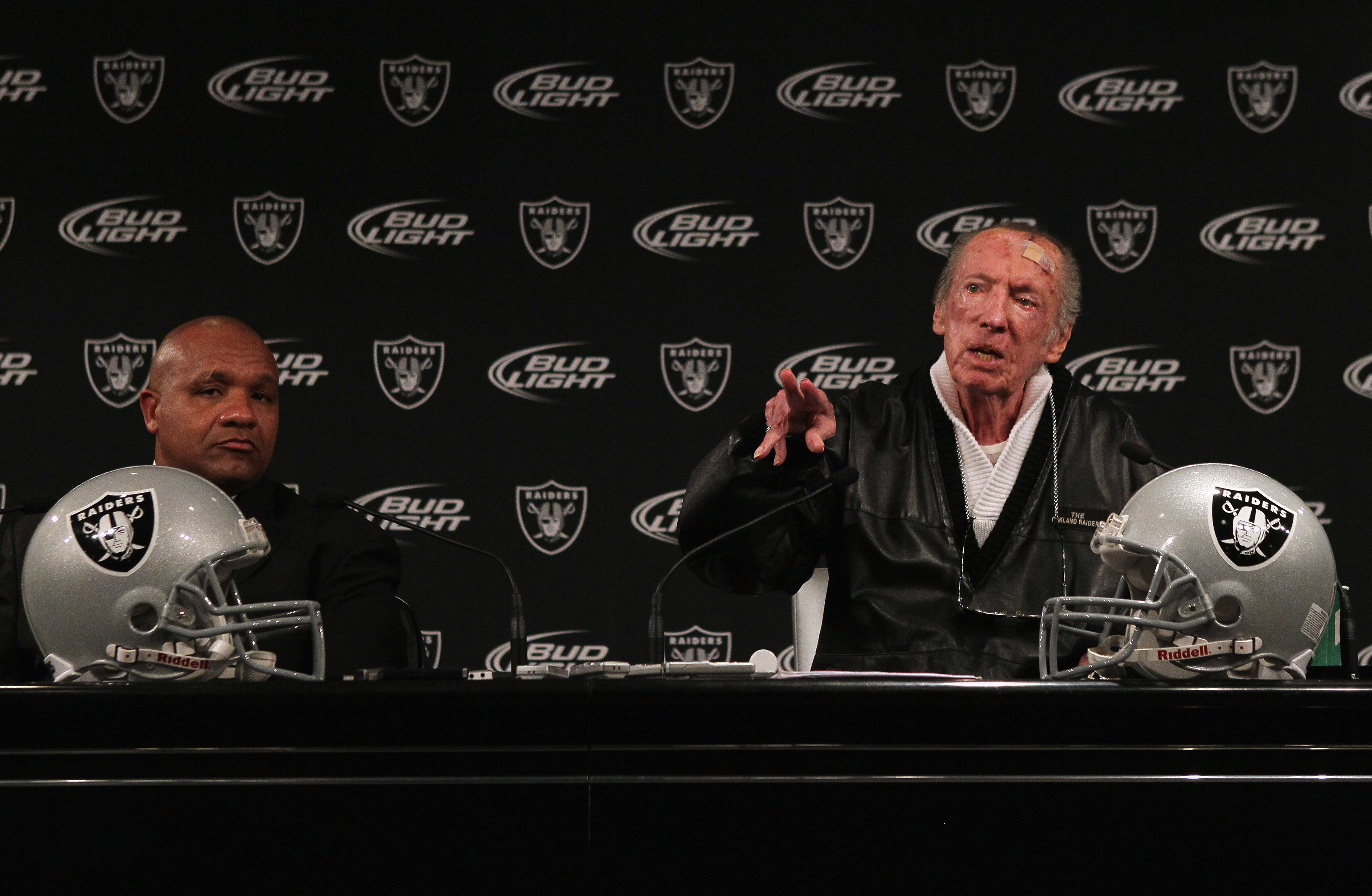 ALAMEDA, CA - JANUARY 18:  New Oakland Raiders coach Hue Jackson (L) looks on as Raiders owner Al Davis speaks during a press conference on January 18, 2011 in Alameda, California. Hue Jackson was introduced as the new coach of the Oakland Raiders, replac