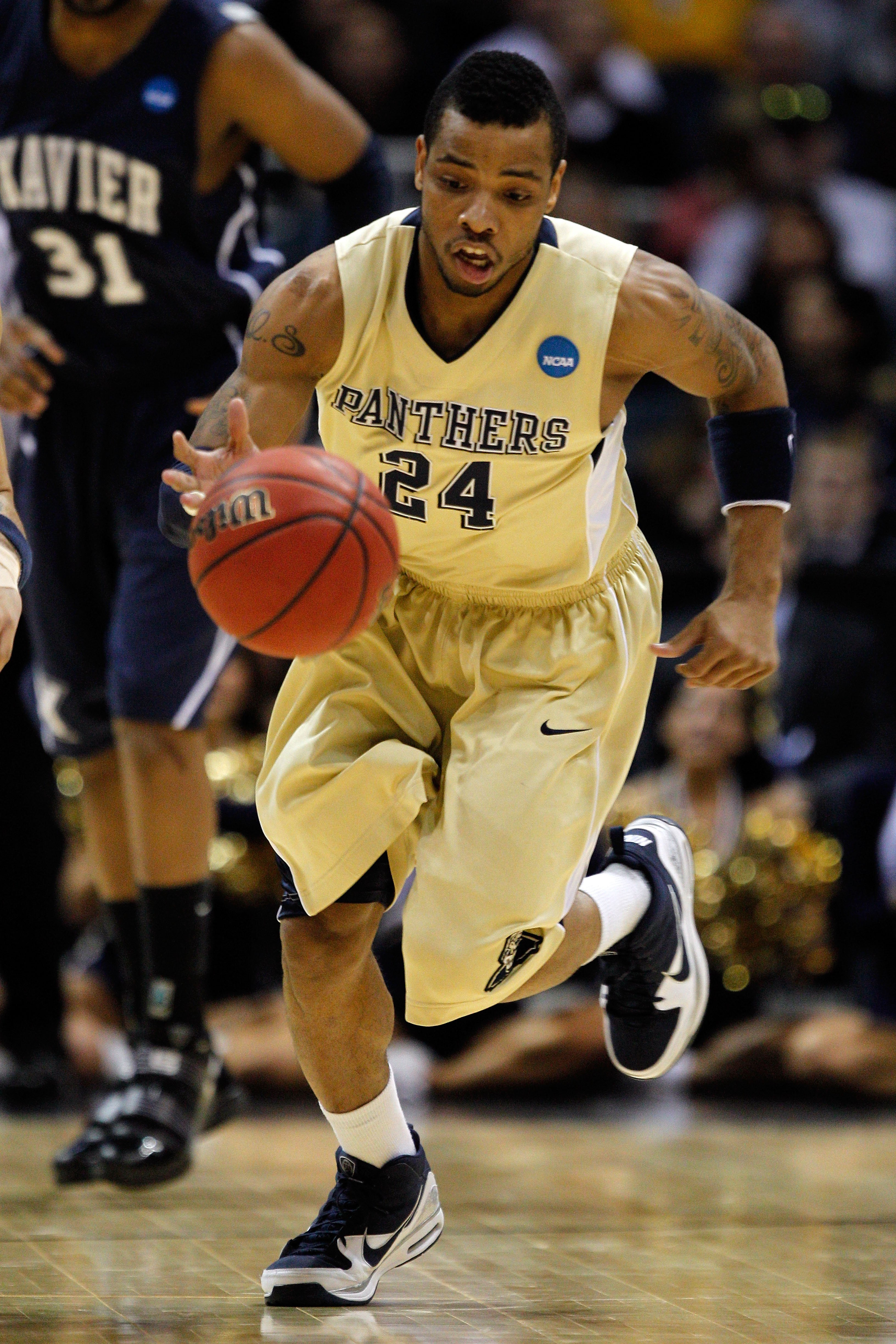 MILWAUKEE - MARCH 21:  Jermaine Dixon #24 of the Pittsburgh Panthers moves the ball against the Xavier Musketeers during the second round of the 2010 NCAA men's basketball tournament at the Bradley Center on March 21, 2010 in Milwaukee, Wisconsin.  (Photo