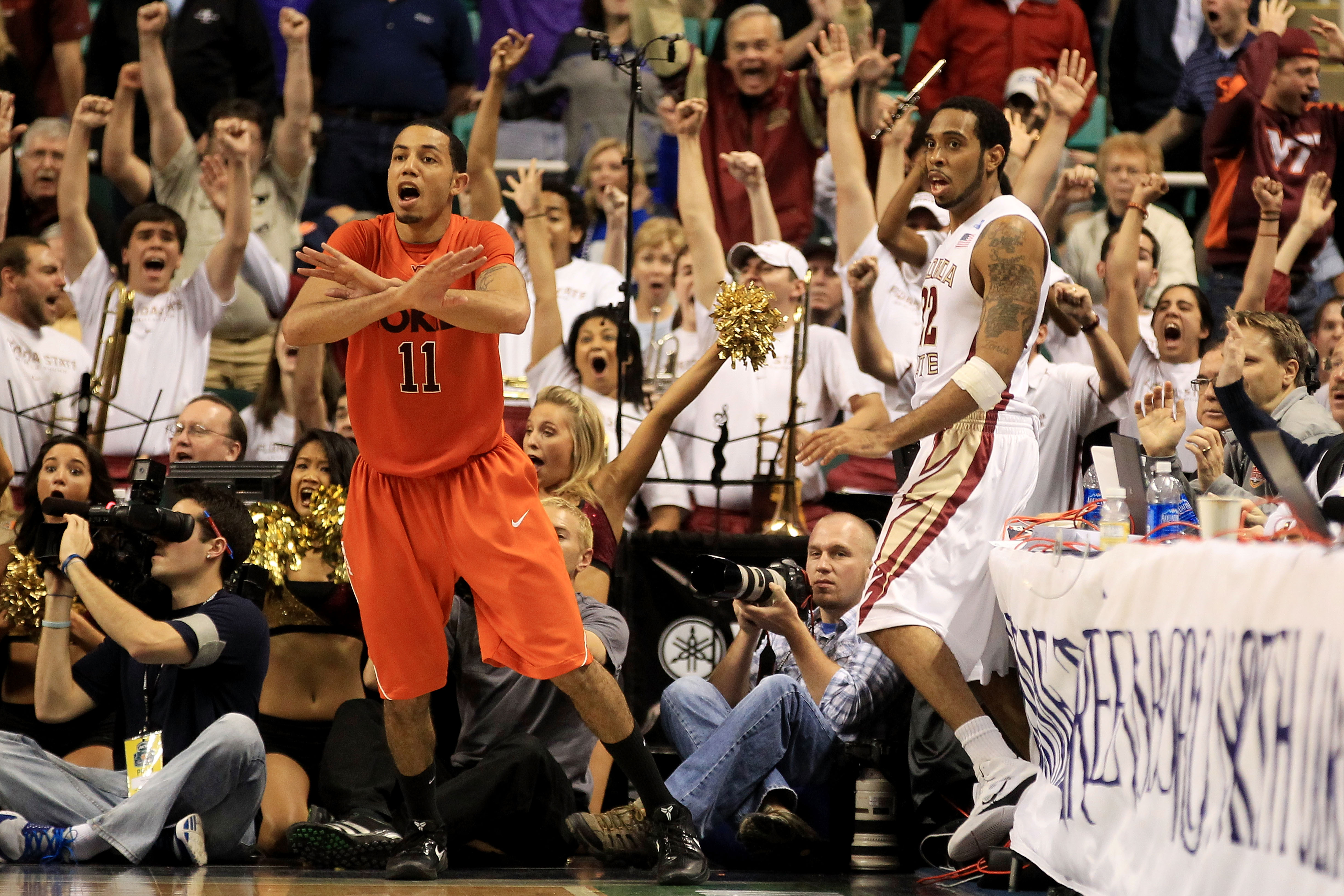GREENSBORO, NC - MARCH 11:  Erick Green #11 of the Virginia Tech Hokies reacts to a shot at the buzzer by Derwin Kitchen #22 of the Florida State Seminoles that would have won the game during the quarterfinals of the 2011 ACC men's basketball tournament a