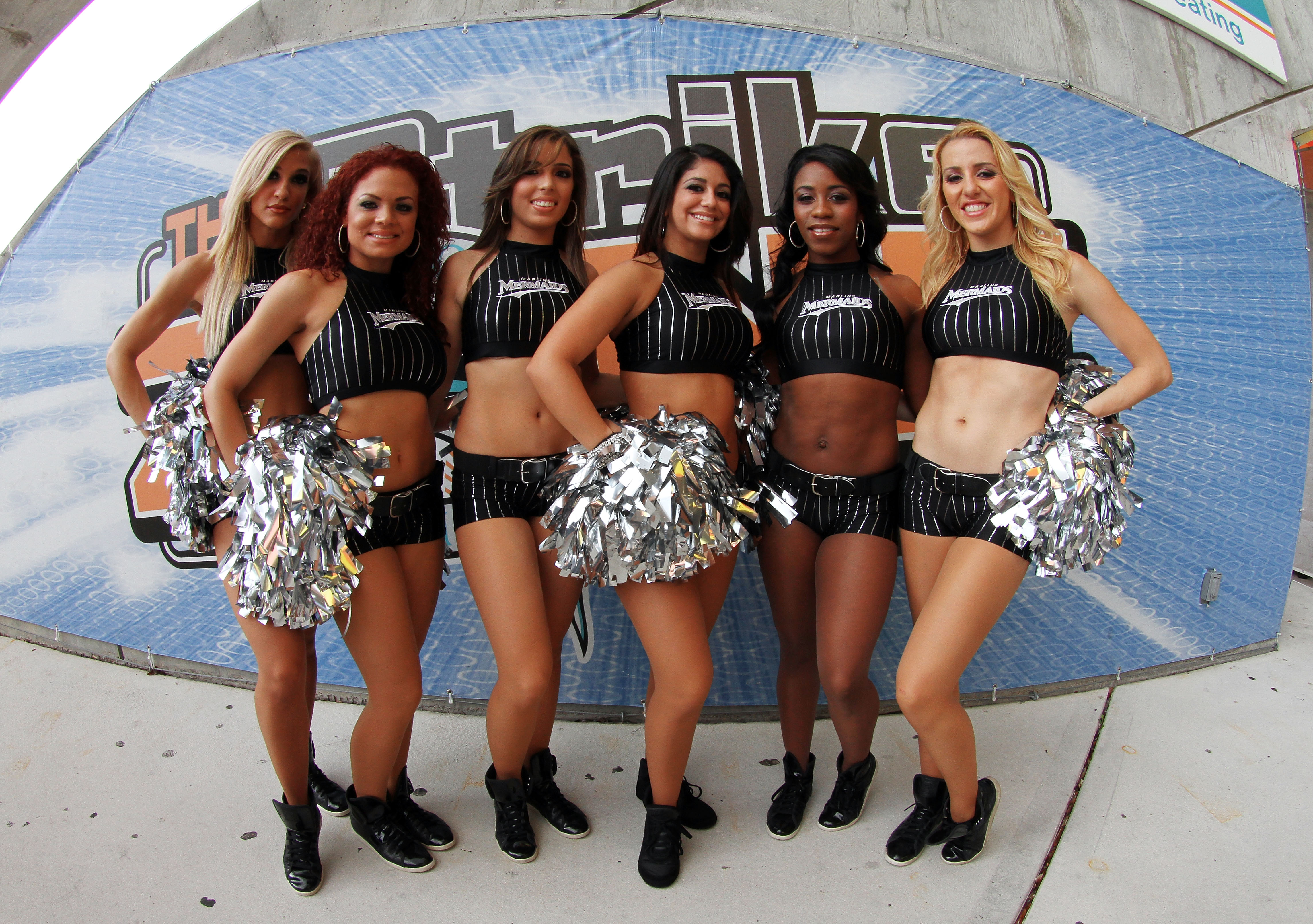 MIAMI - APRIL 09:  Marlins' Mermaids pose for a photo while they greet fans before the Los Angeles Dodgers take on the Florida Marlins during the Marlins home opening game at Sun Life Stadium on April 9, 2010 in Miami, Florida.  (Photo by Doug Benc/Getty