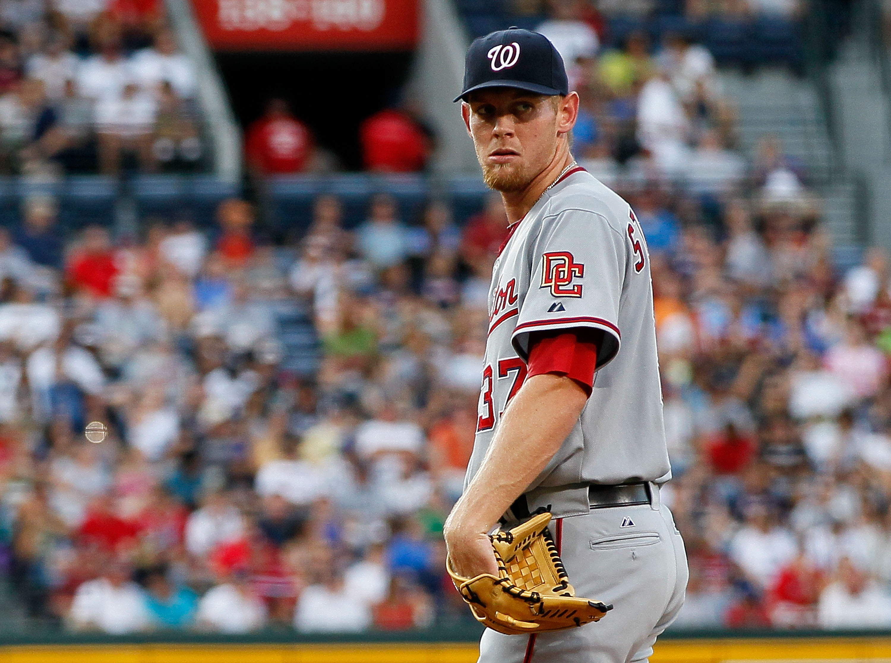 ATLANTA - JUNE 28:  Starting pitcher Stephen Strasburg #37 of the Washington Nationals checks the runner on first base in the second inning against the Atlanta Braves at Turner Field on June 28, 2010 in Atlanta, Georgia.  (Photo by Kevin C. Cox/Getty Imag