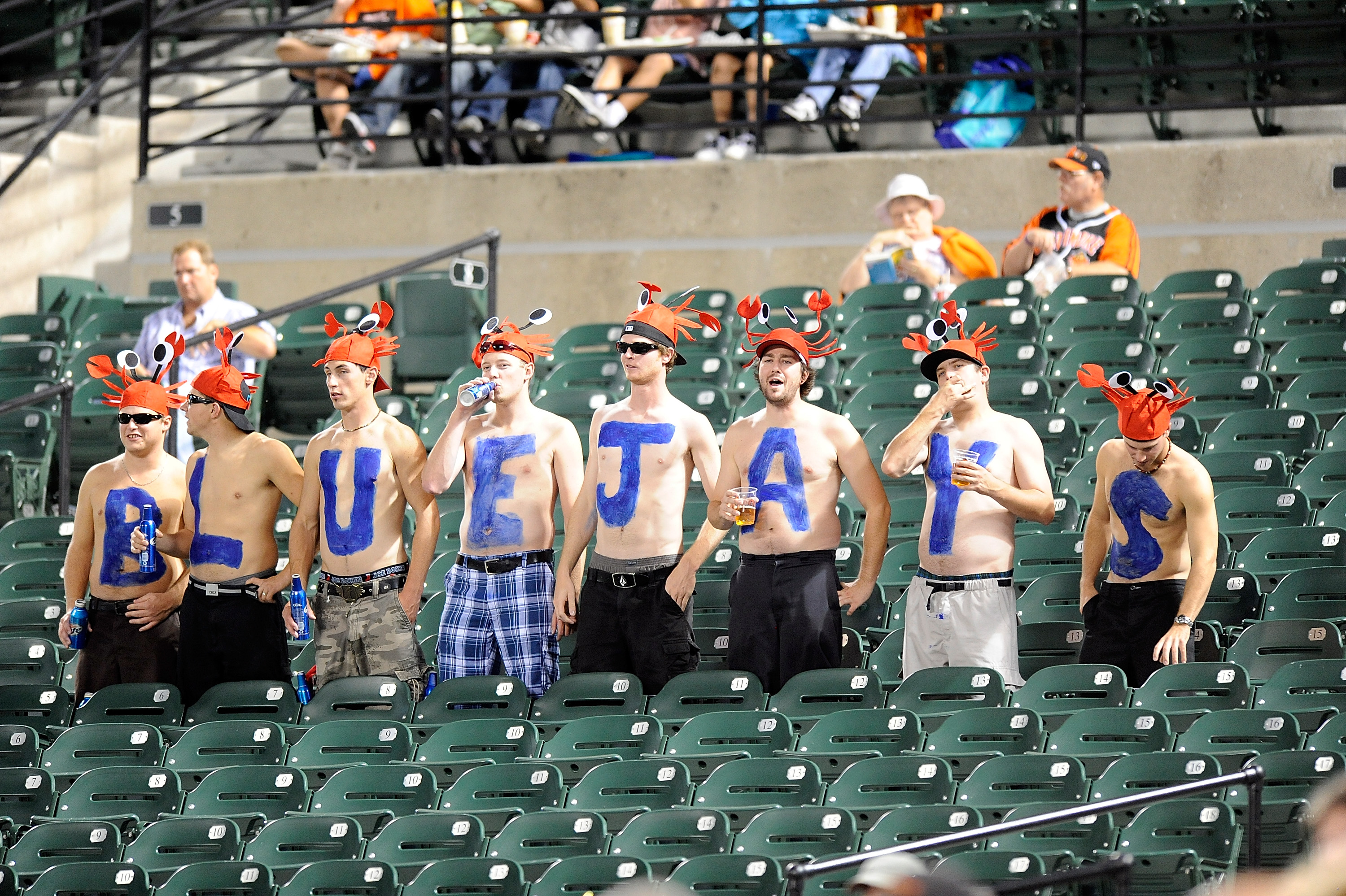 BALTIMORE - SEPTEMBER 13:  Blue Jays fans watch the game between the Toronto Blue Jays and the Baltimore Orioles at Camden Yards on September 13, 2010 in Baltimore, Maryland.  (Photo by Greg Fiume/Getty Images)