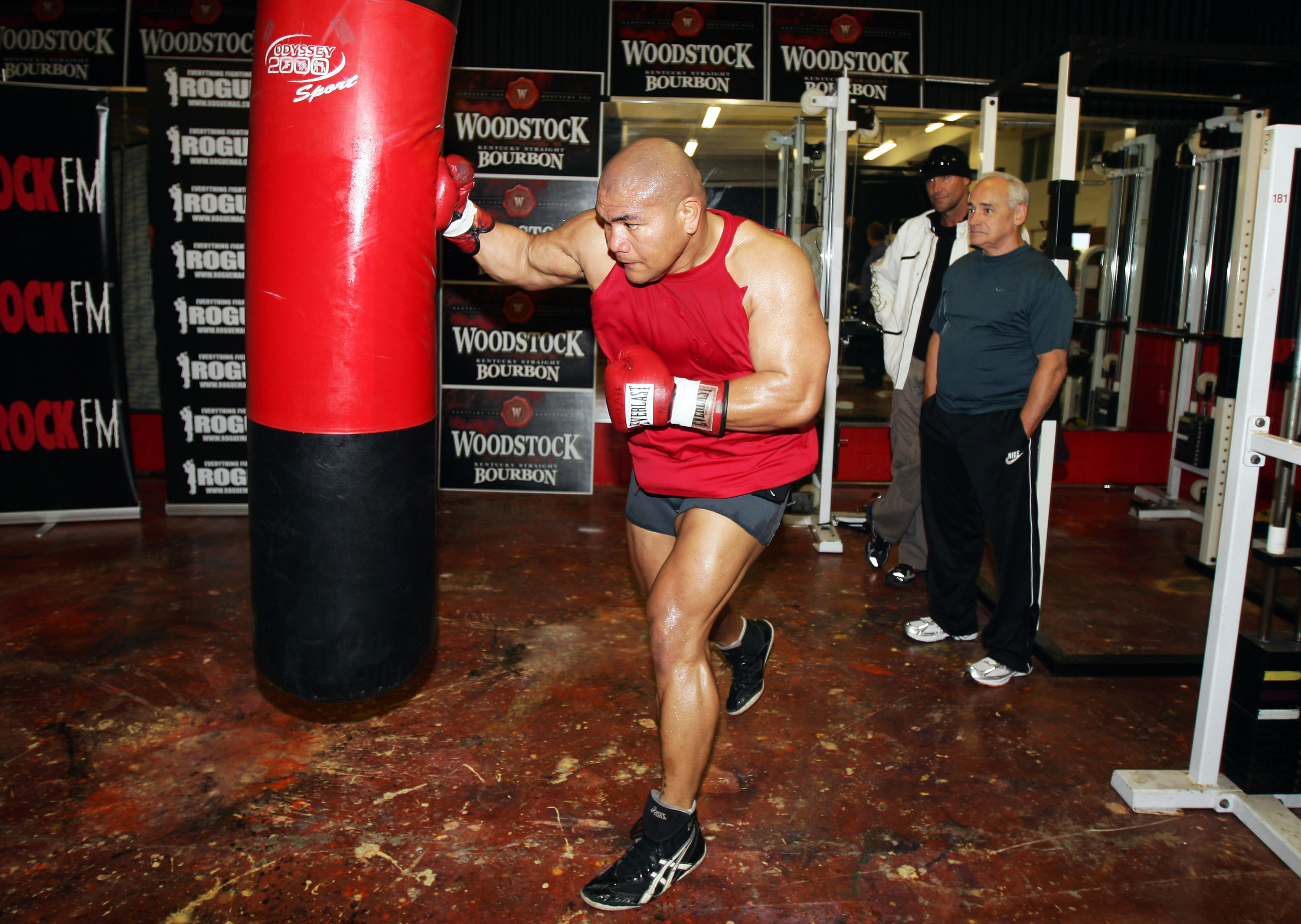 AUCKLAND, NEW ZEALAND - AUGUST 11:  David Tua's trainers Lee Parore and Roger Bloodworth watch him punch the heavy bag during a training session at his gym on August 11, 2009 in Auckland, New Zealand.  (Photo by Sandra Mu/Getty Images)