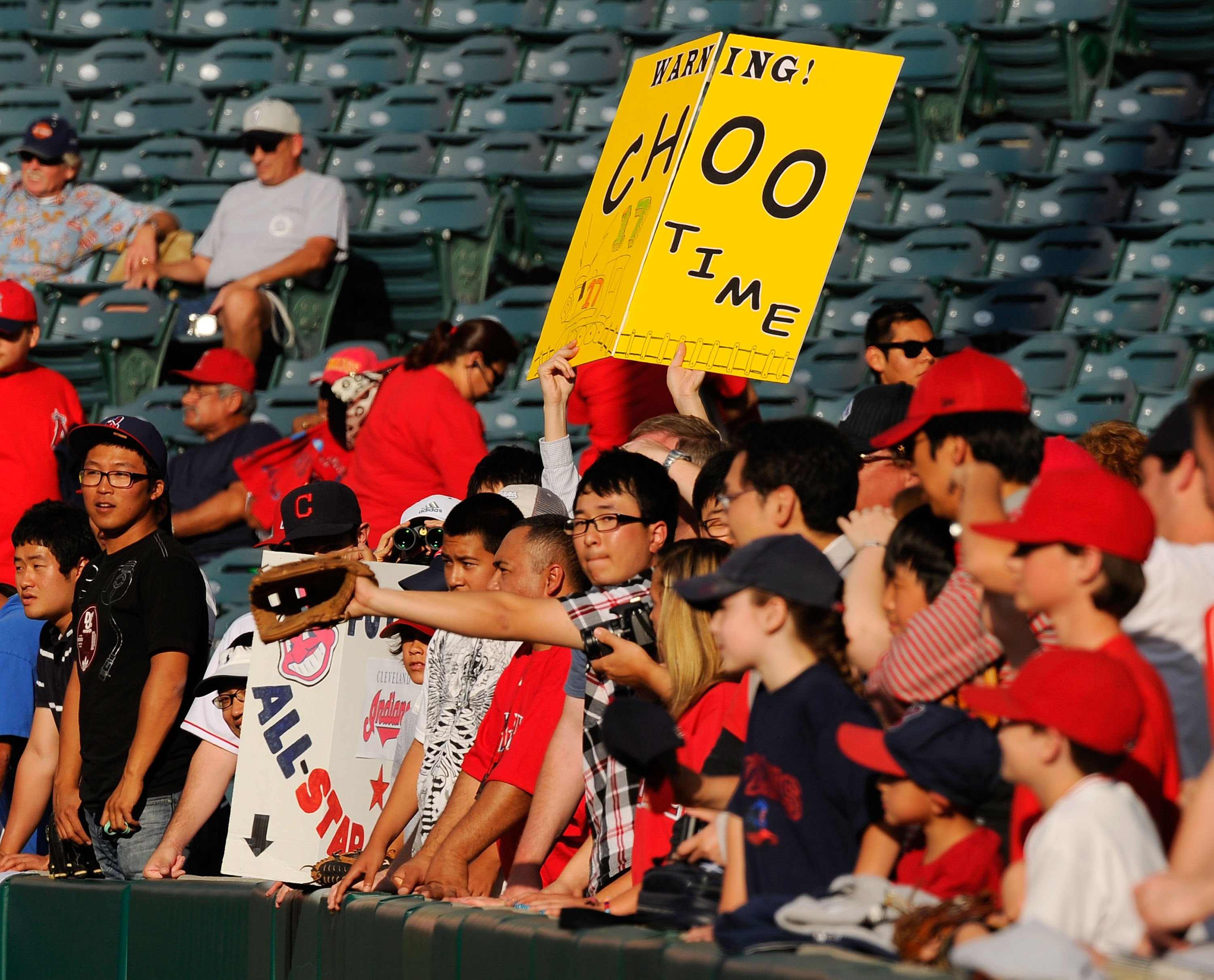 ANAHEIM, CA - APRIL 26:  Fans in support of Shin-Soo Choo #17 Korean right fielder of the Cleveland Indians hold up signs during batting practice before the start of the baseball game against Los Angeles Angels of Anaheim on April 26, 2010 at Angel Stadiu