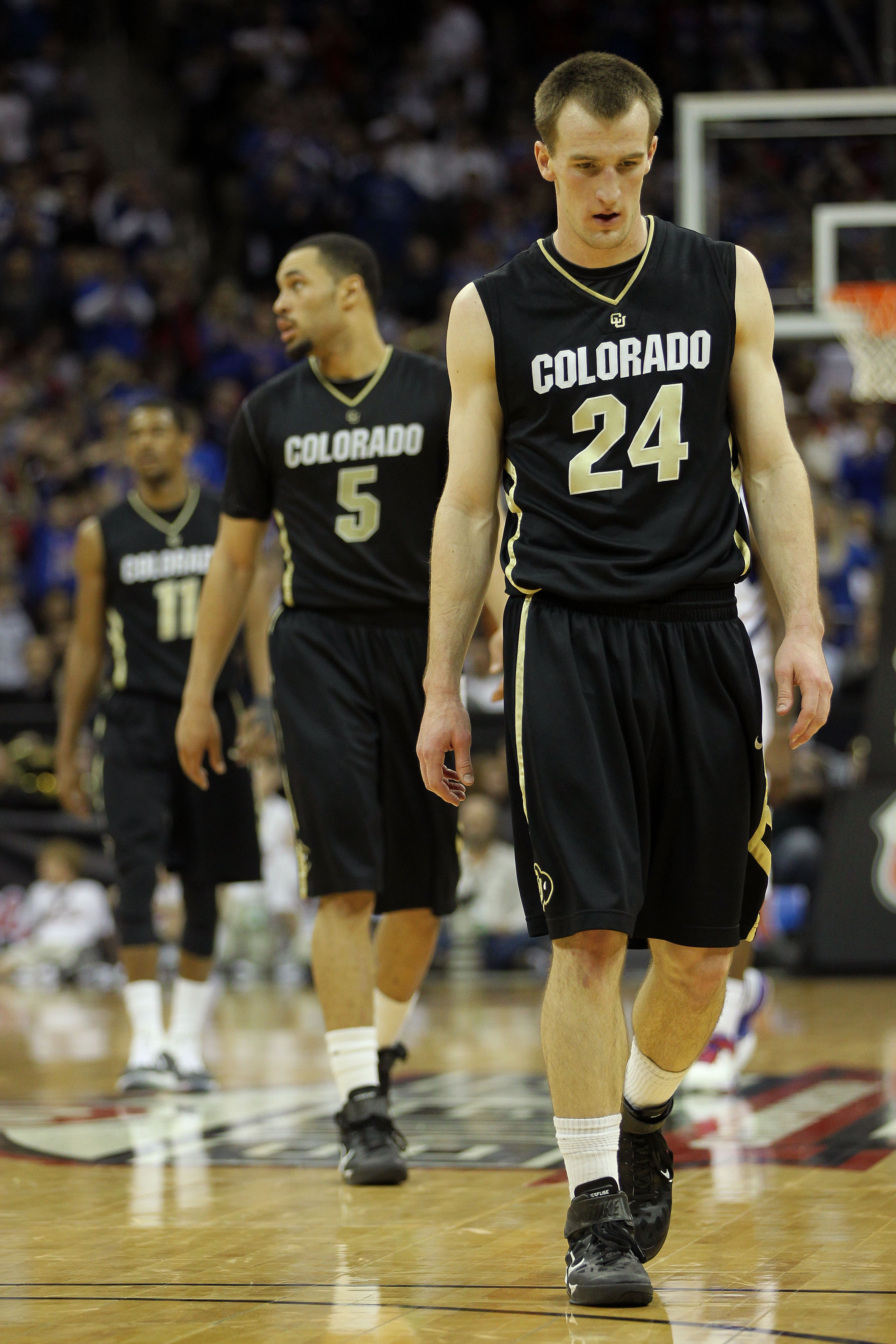 KANSAS CITY, MO - MARCH 11:  Levi Knutson #24, Marcus Relphorde #5 and Cory Higgins #11 of the Colorado Buffaloes walk on the court during their semifinal game against the Kansas Jayhawks in the 2011 Phillips 66 Big 12 Men's Basketball Tournament at Sprin