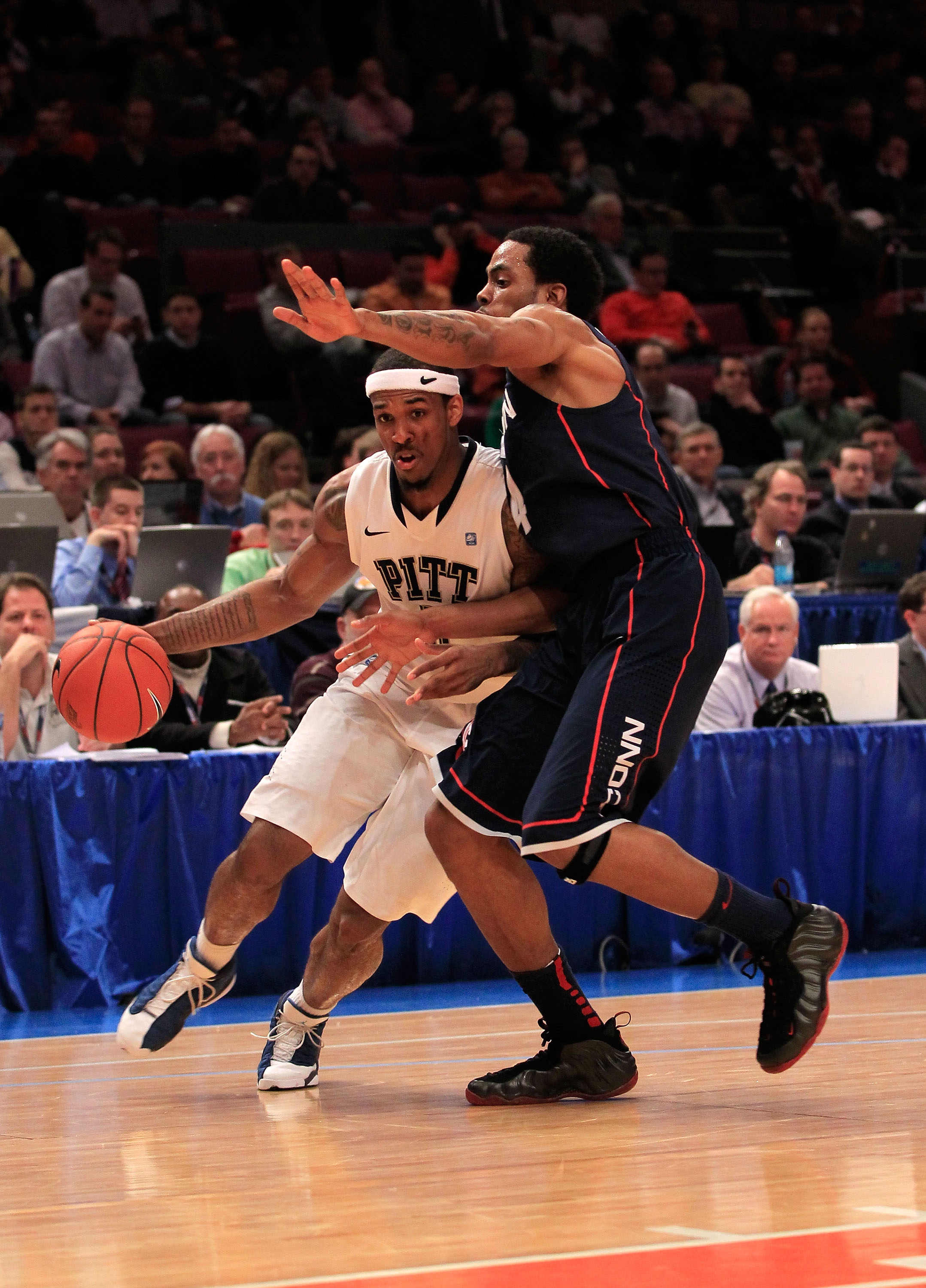 NEW YORK, NY - MARCH 10:  Gilbert Brown #5 of the Pittsburgh Panthers dribbles past Jamal Coombs-McDaniel #4 of the Connecticut Huskies during the quarterfinals of the 2011 Big East Men's Basketball Tournament presented by American Eagle Outfitters  at Ma