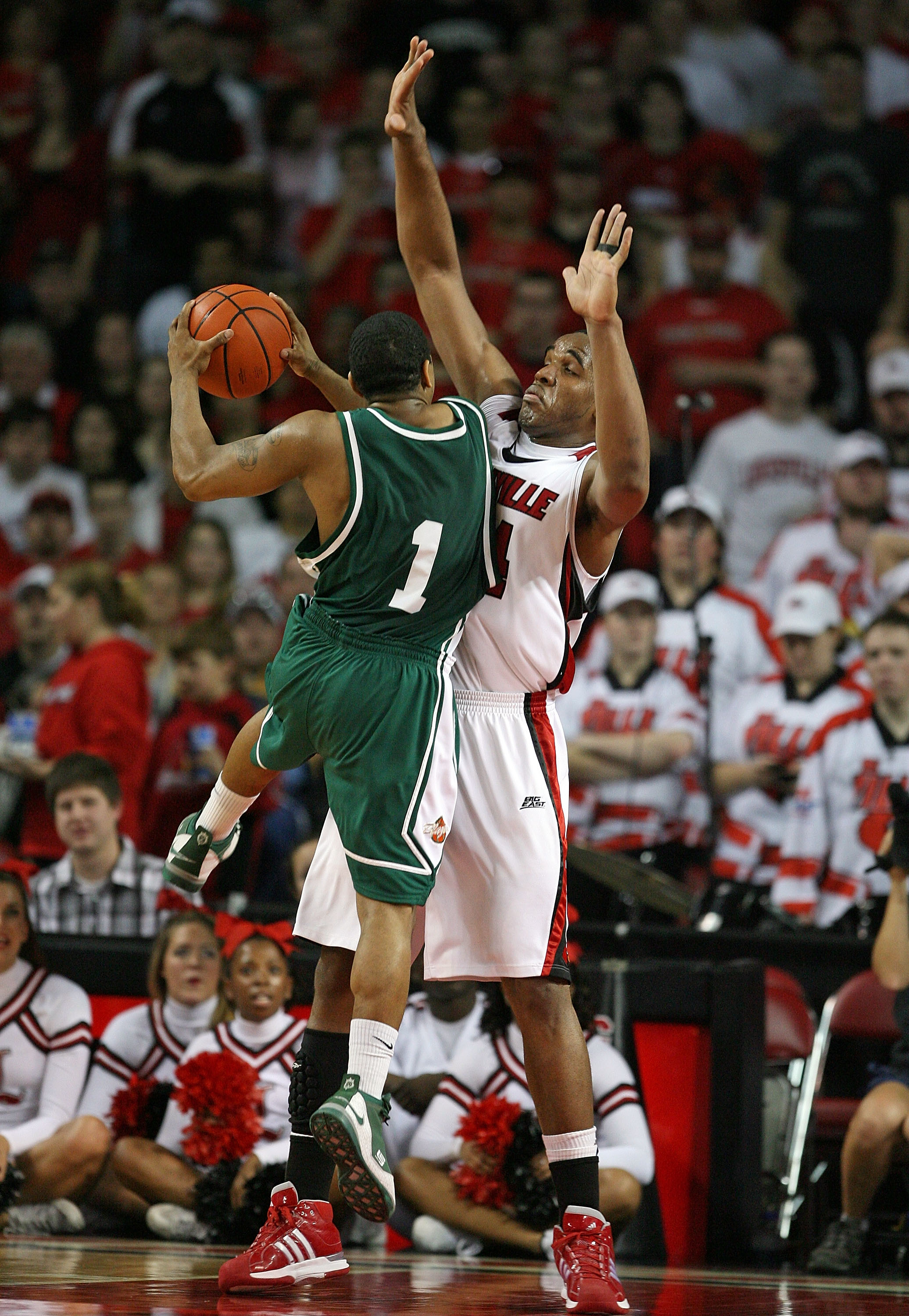 LOUISVILLE, KY - DECEMBER 27:  Samardo Samuels #24 of the Louisville Cardinals puts defensive pressure on Aaron Johnson #1 of the UAB Blazers during the game on December 27, 2008 at Freedom Hall in Louisville, Kentucky.  Louisville won 82-62.  (Photo by A