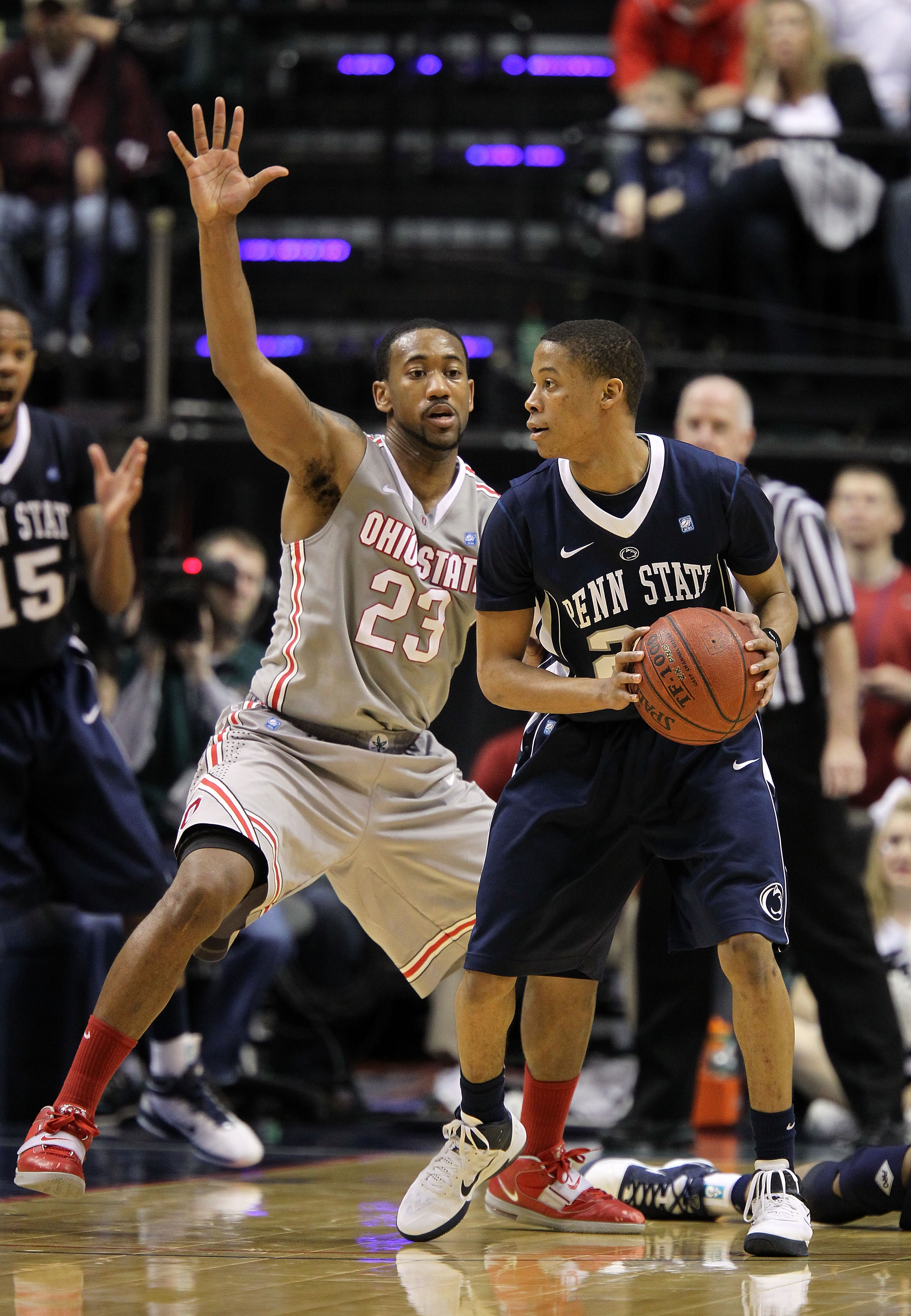 INDIANAPOLIS, IN - MARCH 13:  Tim Frazier #23 of the Penn State Nittany Lions looks to pass the ball against David Lighty #23 of the Ohio State Buckeyes during the championship game of the 2011 Big Ten Men's Basketball Tournament at Conseco Fieldhouse on