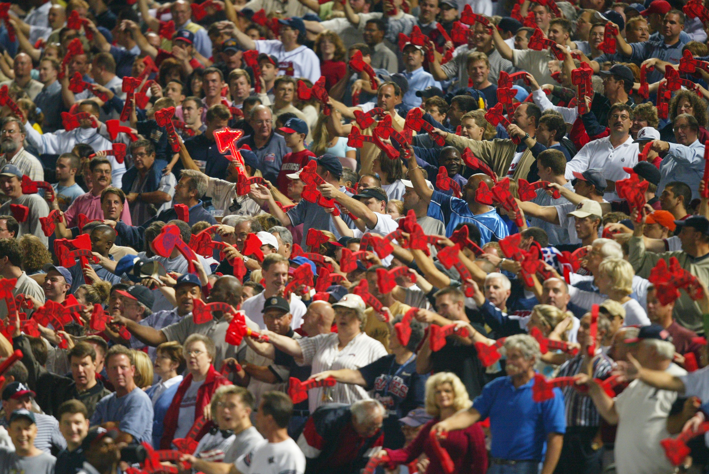 ATLANTA - OCTOBER 7:  Fans of the Atlanta Braves do the tomahawk chop during game five of the National League Division Series against the San Francisco Giants on October 7, 2002  at Turner Field in Atlanta, Georgia.  The Giants won 3-1.  (Photo by Jamie S