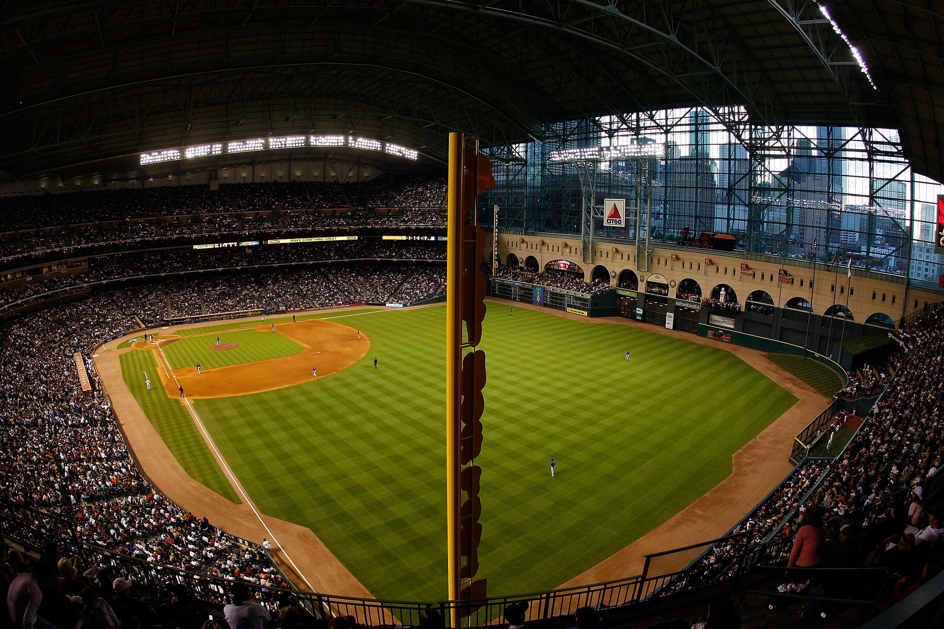 HOUSTON - APRIL 06:  Fans watch the Opening Day game against the Chicago Cubs and the Houston Astros on April 6, 2009 at Minute Maid Park in Houston, Texas.  (Photo by Chris Graythen/Getty Images)