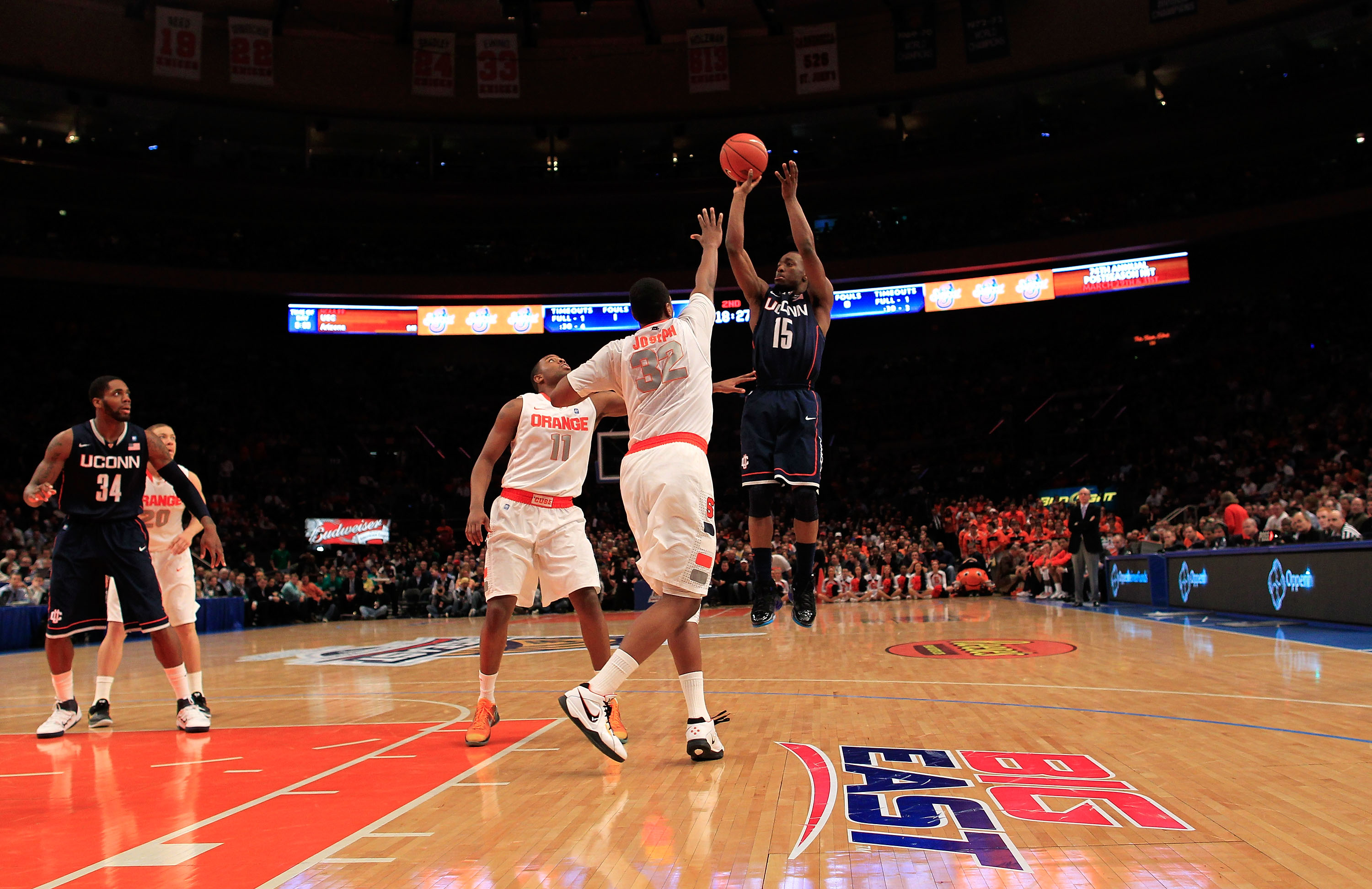 NEW YORK, NY - MARCH 11: Kemba Walker #15 of the Connecticut Huskies shoots over Kris Joseph #32 of the Syracuse Orange during the semifinals of the 2011 Big East Men's Basketball Tournament presented by American Eagle Outfitters at Madison Square Garden