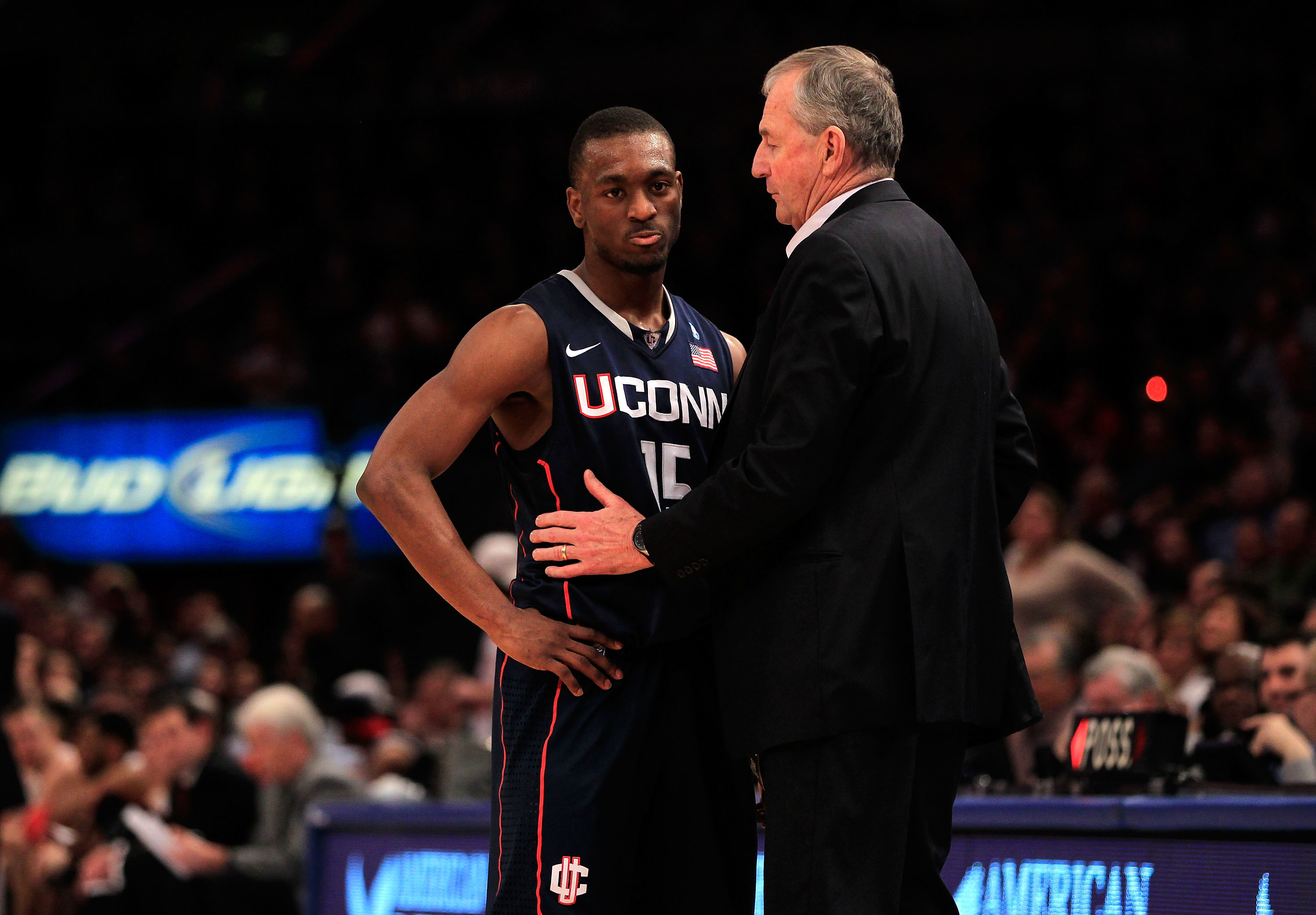 NEW YORK, NY - MARCH 12: Kemba Walker #15 of the Connecticut Huskies speaks with head coach Jim Calhoun during the championship of the 2011 Big East Men's Basketball Tournament presented by American Eagle Outfitters at Madison Square Garden on March 12, 2
