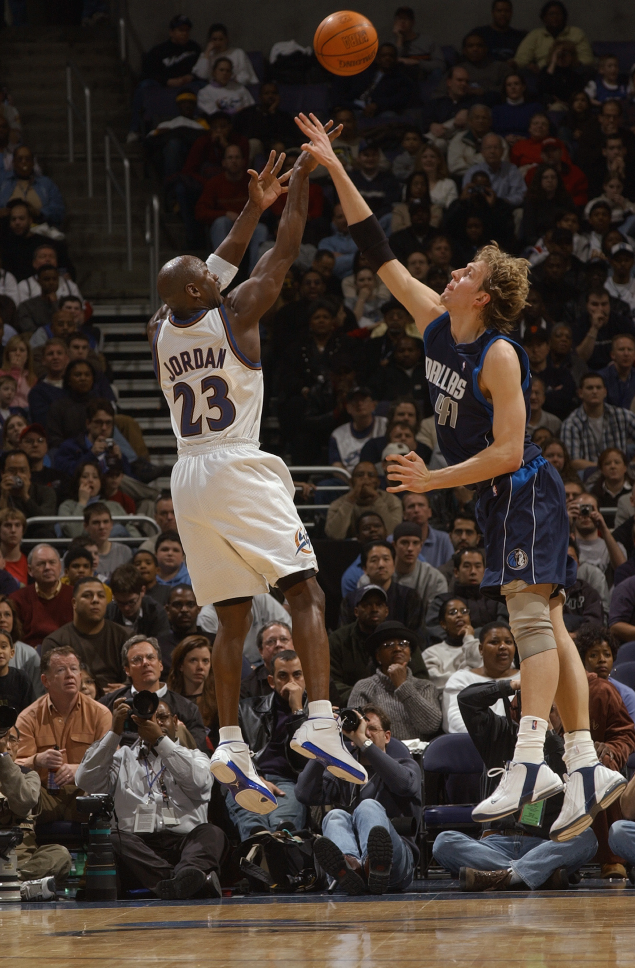 WASHINGTON - FEBRUARY 23:  Michael Jordan #23 of the Washington Wizards shoots over Dirk Nowitzki #41 of the Dallas Mavericks during the NBA game at MCI Center on February 23, 2003 in Washington, D.C.  The Mavericks won in overtime 106-101.  NOTE TO USER: