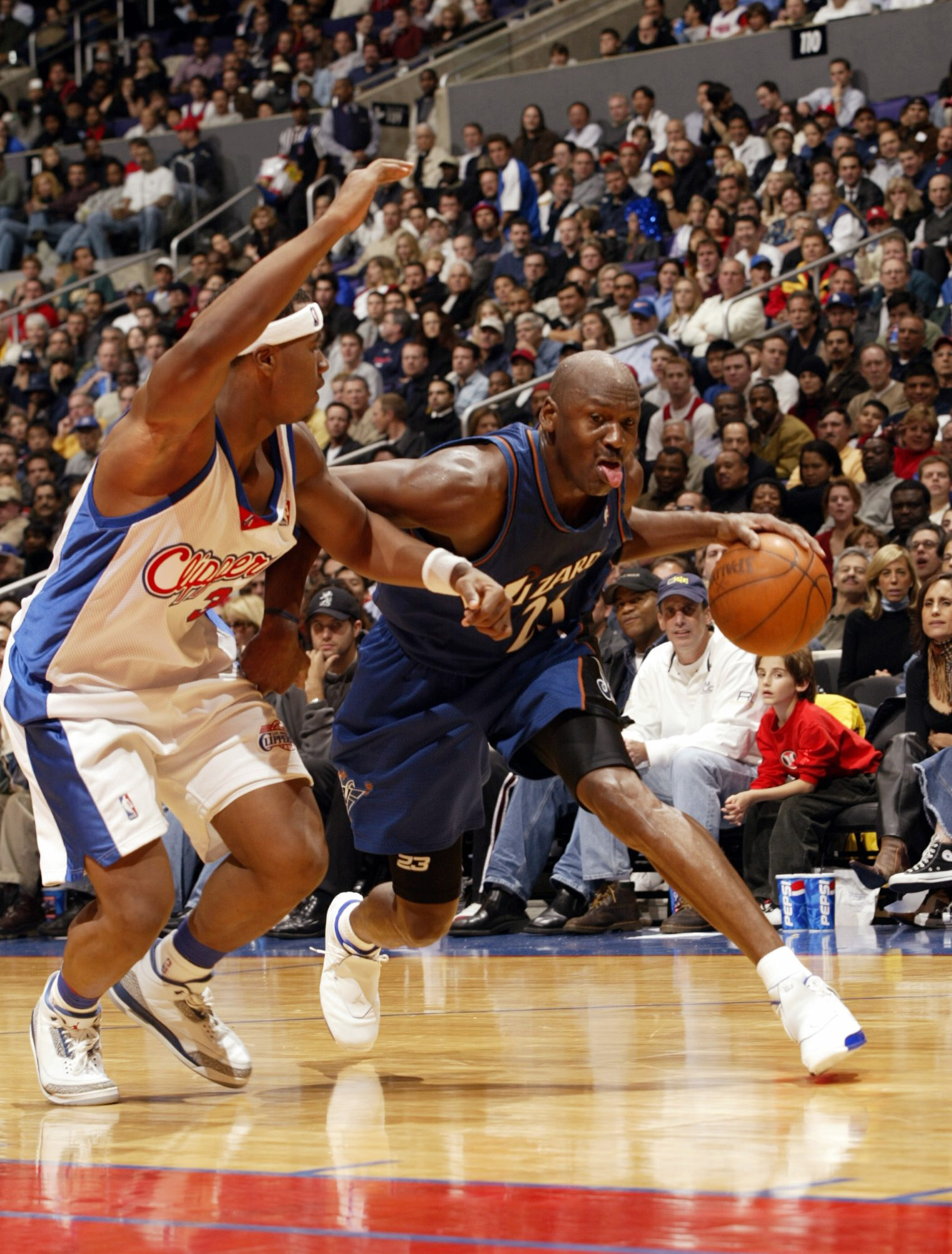 LOS ANGELES - FEBRUARY 12:  Michael Jordan #23 of   the Washington Wizards drives past Quentin Richardson #3 of the Los Angeles Clippers on February 12, 2003 at Staples Center in Los Angeles, California.  The Wizards won 108-104.  (Photo by Stephen Dunn/G