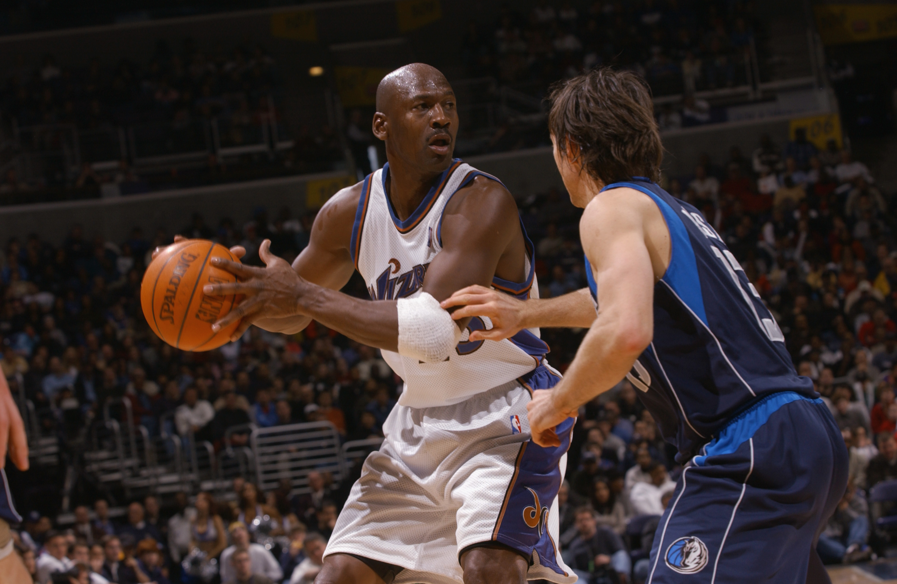 WASHINGTON - FEBRUARY 23:  Michael Jordan #23 of the Washington Wizards is defended by Steve Nash #13 of the Dallas Mavericks during the NBA game at MCI Center on February 23, 2003 in Washington, D.C.  The Mavericks won in overtime 106-101.  NOTE TO USER: