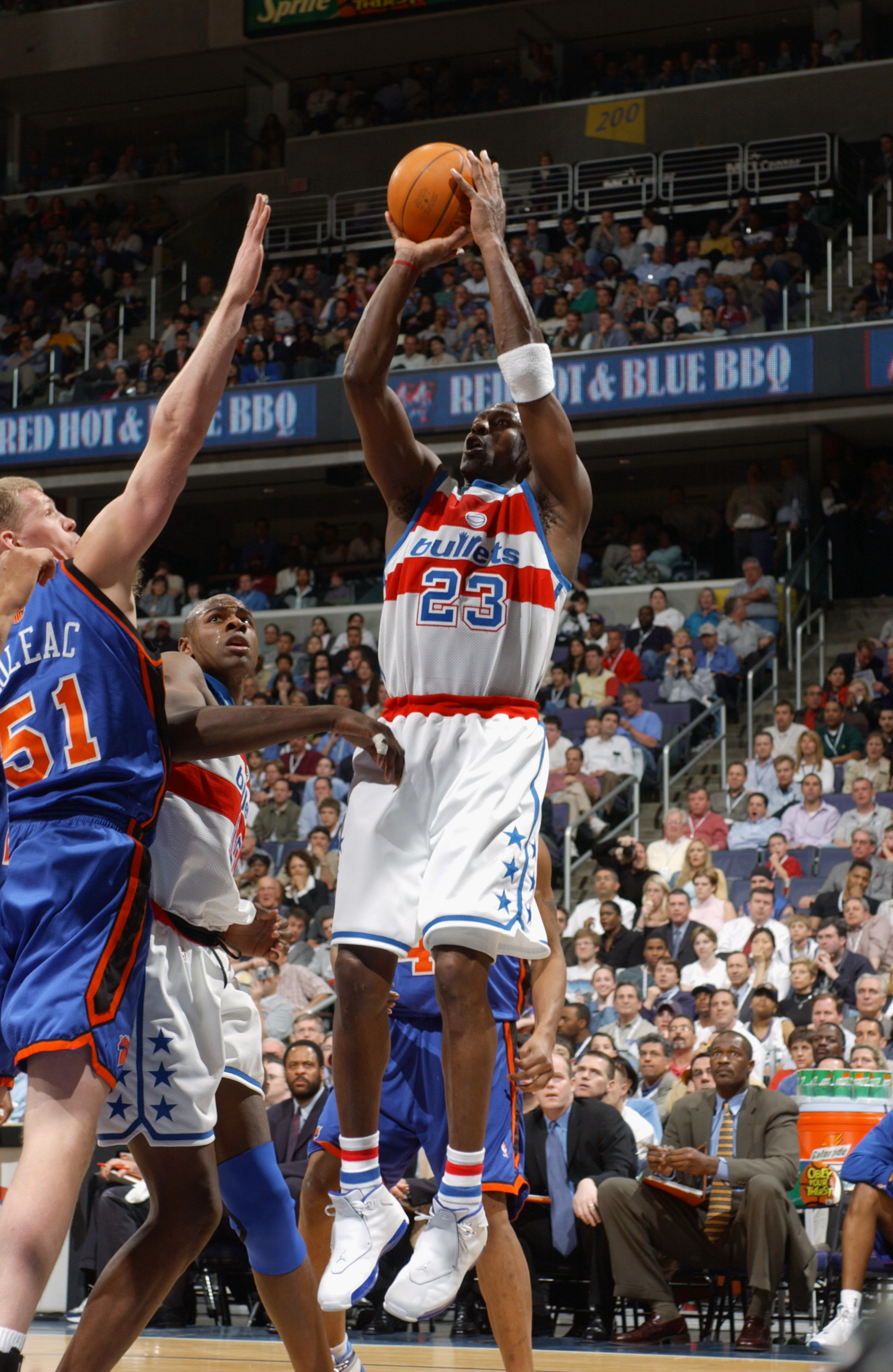 WASHINGTON - APRIL 14:  Michael Jordan #23 of the Washington Wizards shoots a jump shot over Michael Doleac #51 of the New York Knicks during Jordan's final home game at MCI Center on April 14, 2003 in Washington, DC.  The Knicks won 93-79.  NOTE TO USER: