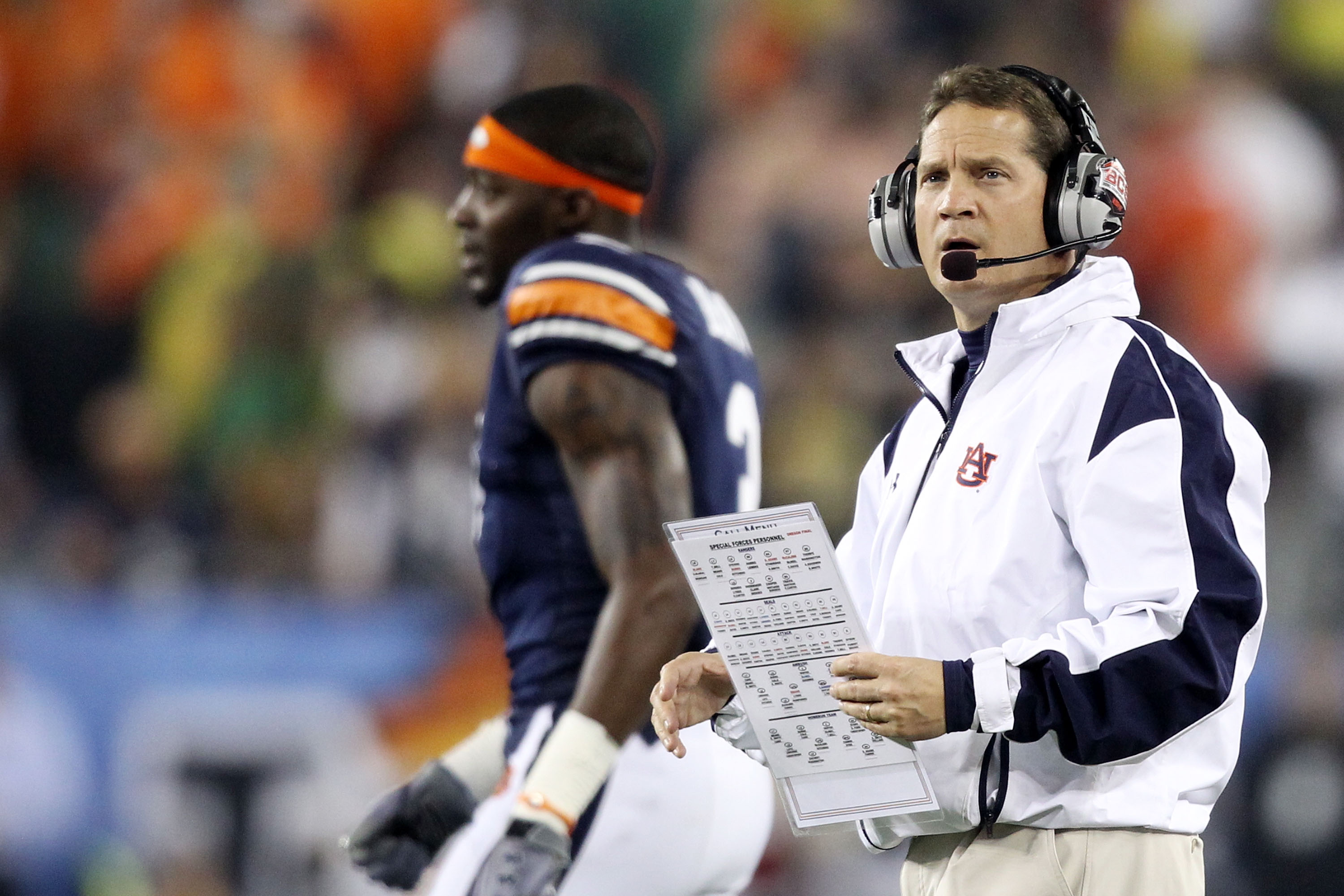GLENDALE, AZ - JANUARY 10:  Head coach Gene Chizik of the Auburn Tigers looks  on from the sideline against the Oregon Ducks during the Tostitos BCS National Championship Game at University of Phoenix Stadium on January 10, 2011 in Glendale, Arizona.  (Ph