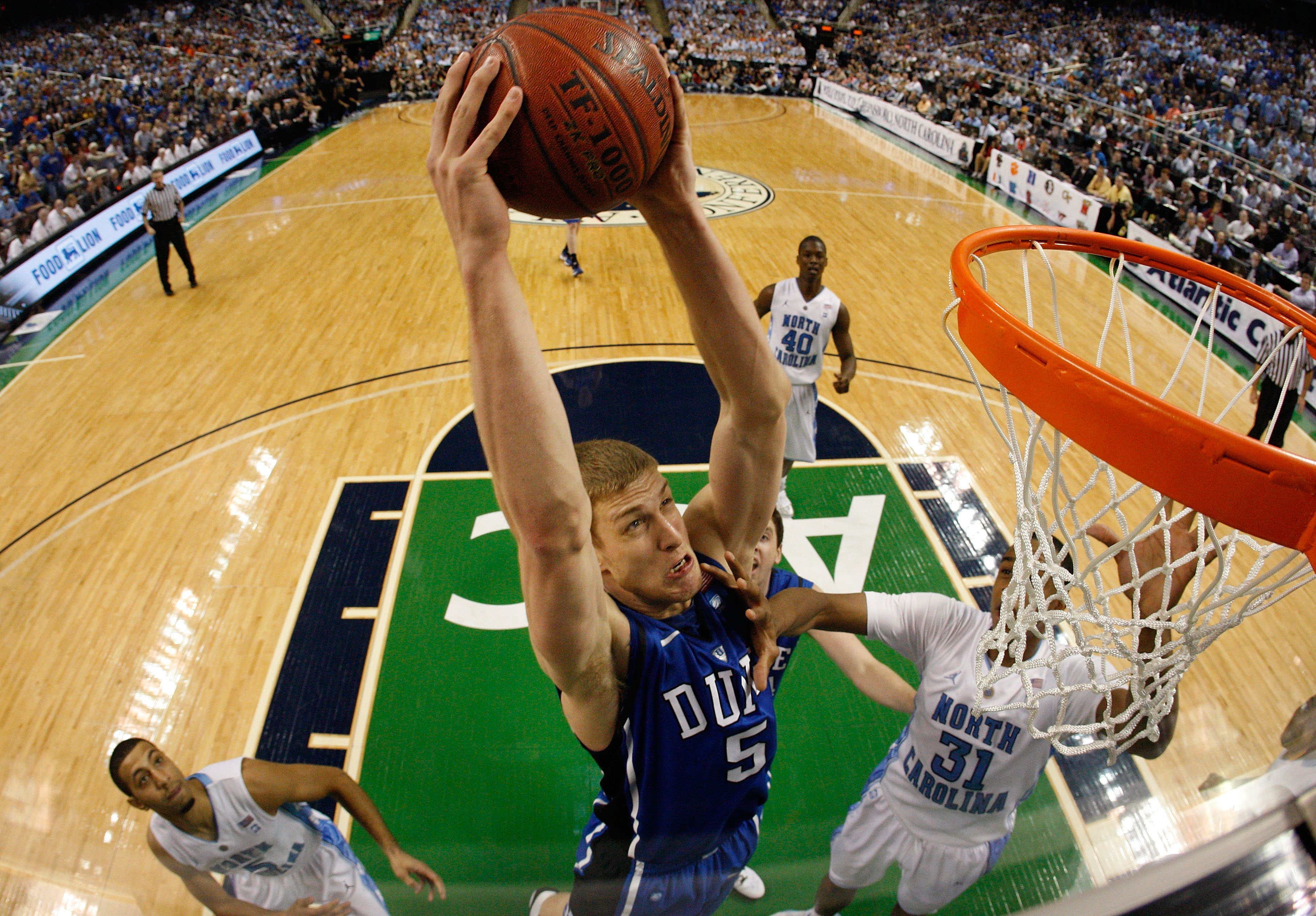 GREENSBORO, NC - MARCH 13:  Mason Plumlee #5 of the Duke Blue Devils shoots against John Henson #31 of the North Carolina Tar Heels in the championship game of the 2011 ACC men's basketball tournament at the Greensboro Coliseum on March 13, 2011 in Greens
