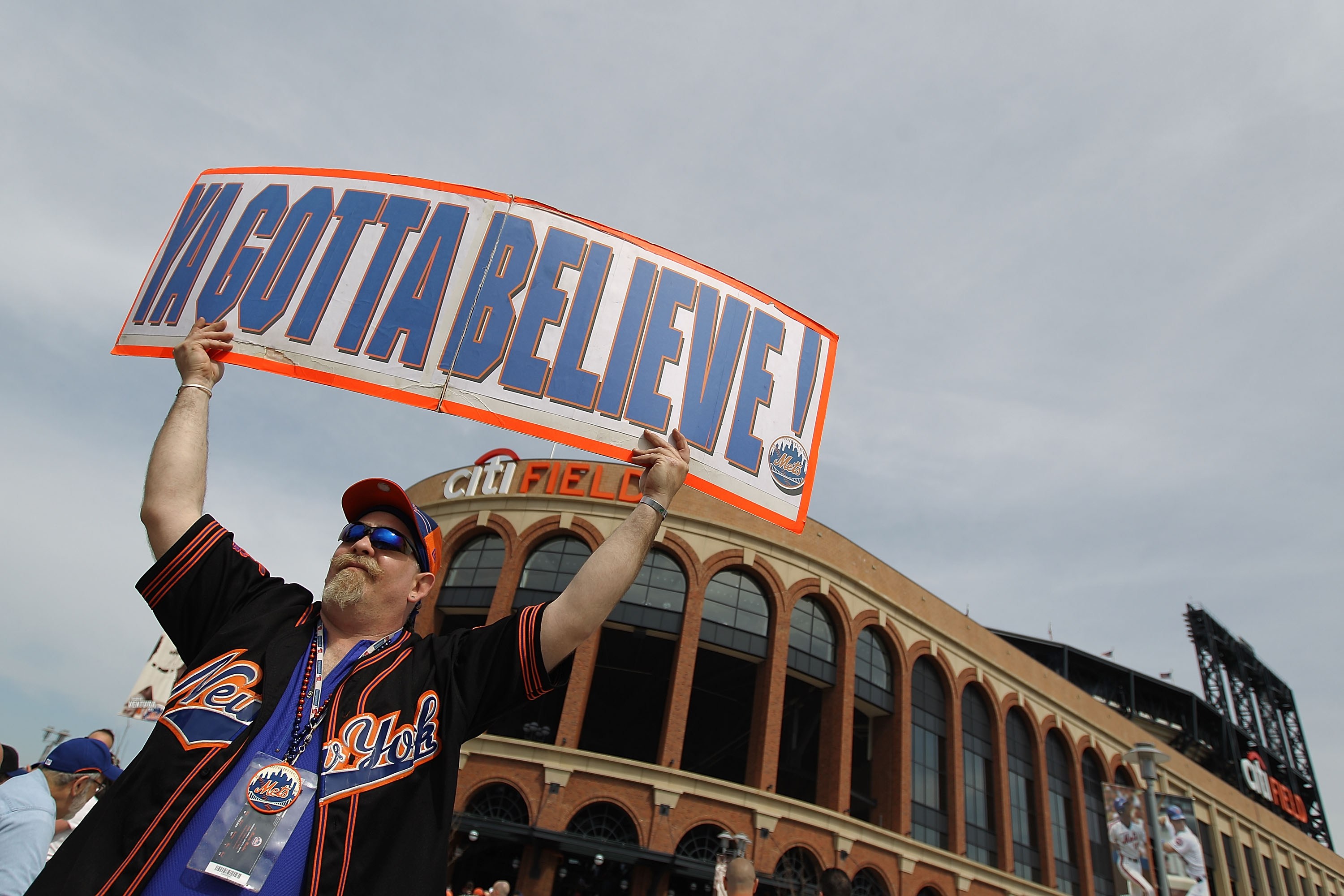 NEW YORK - APRIL 05:  Fans outside the stadium prior to the Opening Day Game between the New York Mets and the Florida Marlins at Citi Field on April 5, 2010 in the Flushing neighborhood of the Queens borough of New York City.  (Photo by Nick Laham/Getty