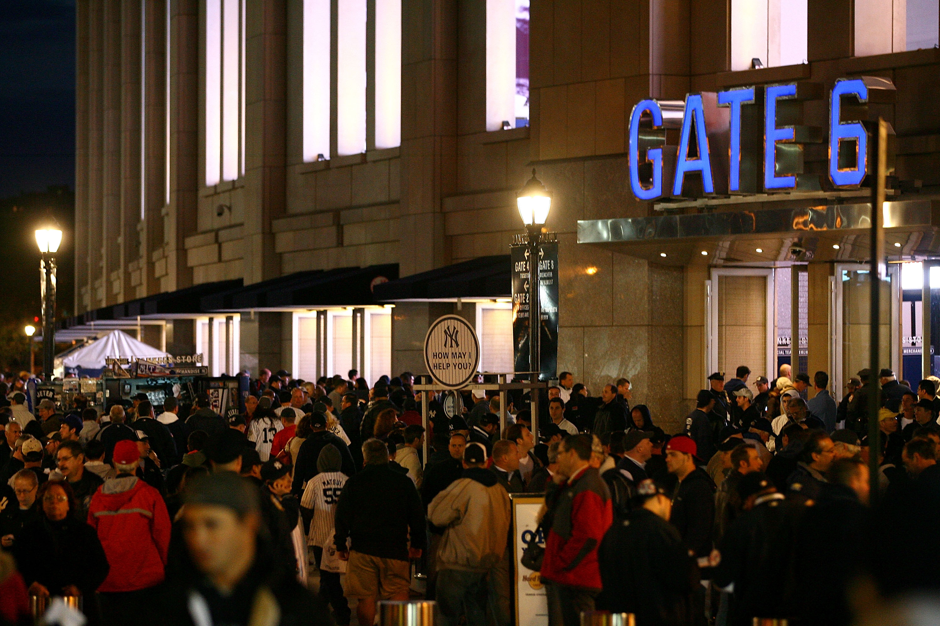 NEW YORK - OCTOBER 18:  Fans walks outside of Yankee Stadium before Game Three of the ALCS between the New York Yankees and the Texas Rangers during the 2010 MLB Playoffs at Yankee Stadium on October 18, 2010 in New York, New York.  (Photo by Andrew Burto