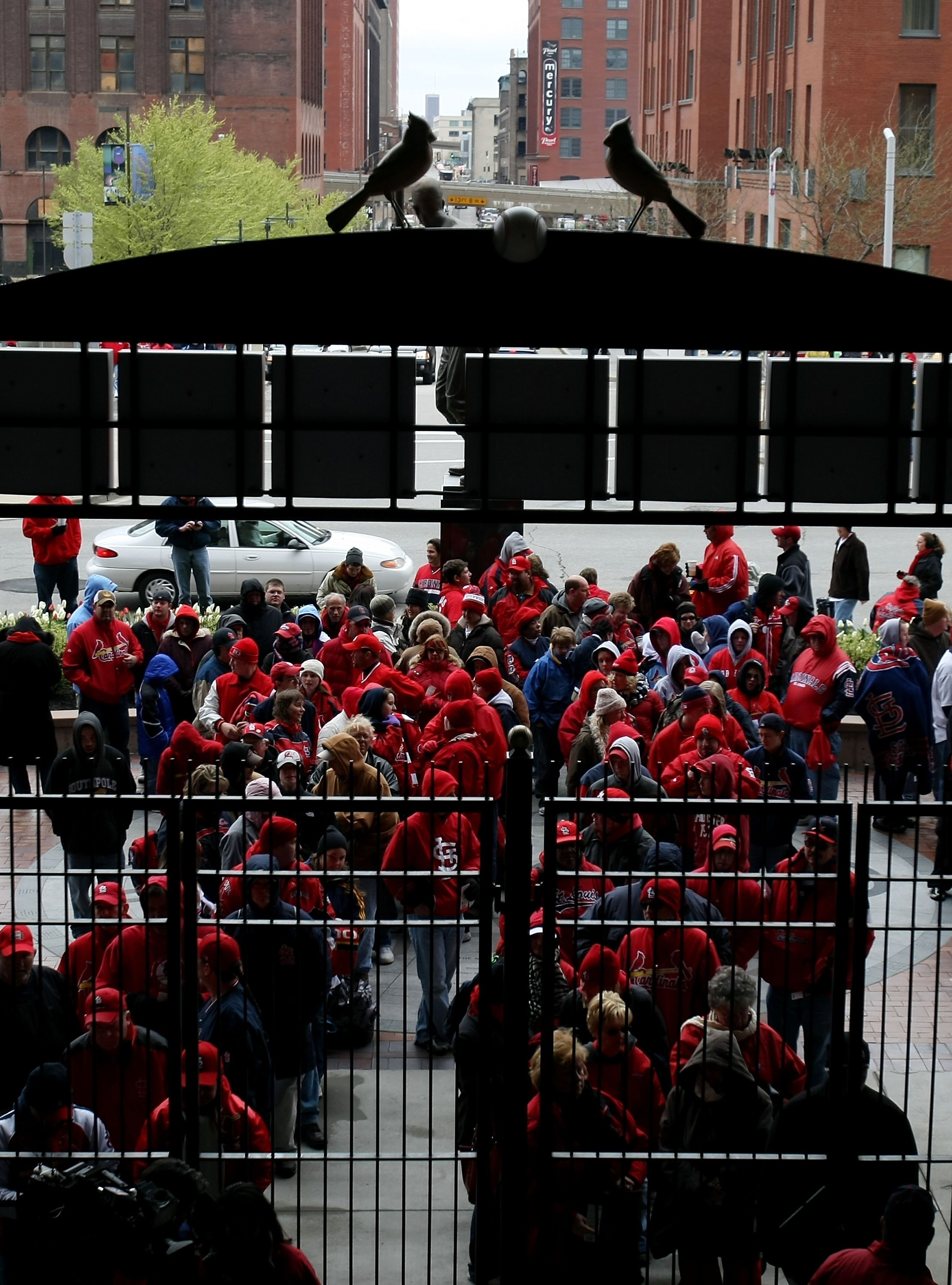 ST. LOUIS - APRIL 06:  Fans line outside the third base gate before the game between the St. Louis Cardinals and the Pittsburgh Pirates during Opening Day on April 6, 2009  at Busch Stadium in St. Louis, Missouri.  (Photo by Elsa/Getty Images)