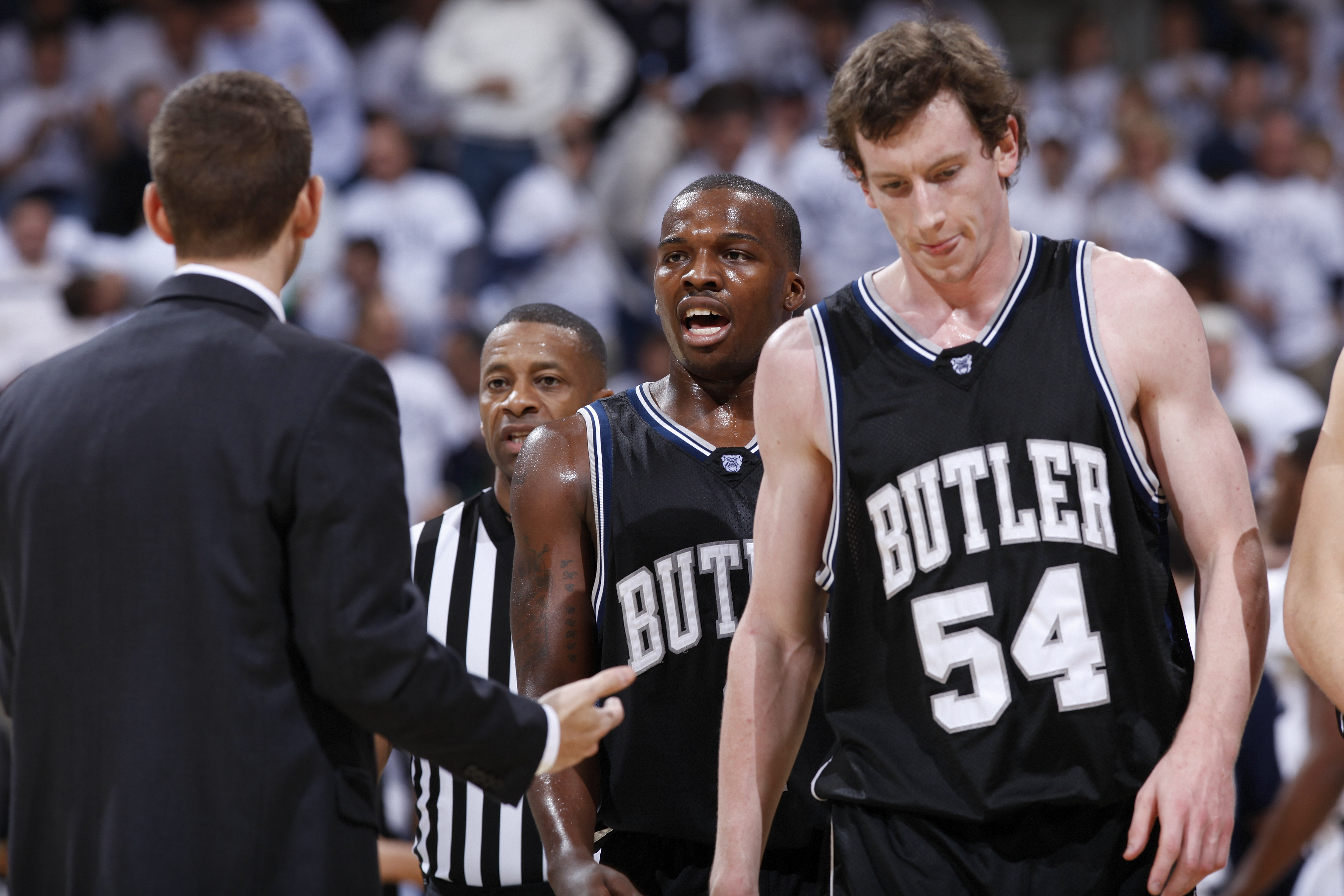 CINCINNATI, OH - DECEMBER 9: Shelvin Mack #1 and Matt Howard #54 of the Butler Bulldogs come off the floor during a timeout in the game against the Xavier Musketeers at Cintas Center on December 9, 2010 in Cincinnati, Ohio. Xavier defeated Butler 51-49. (