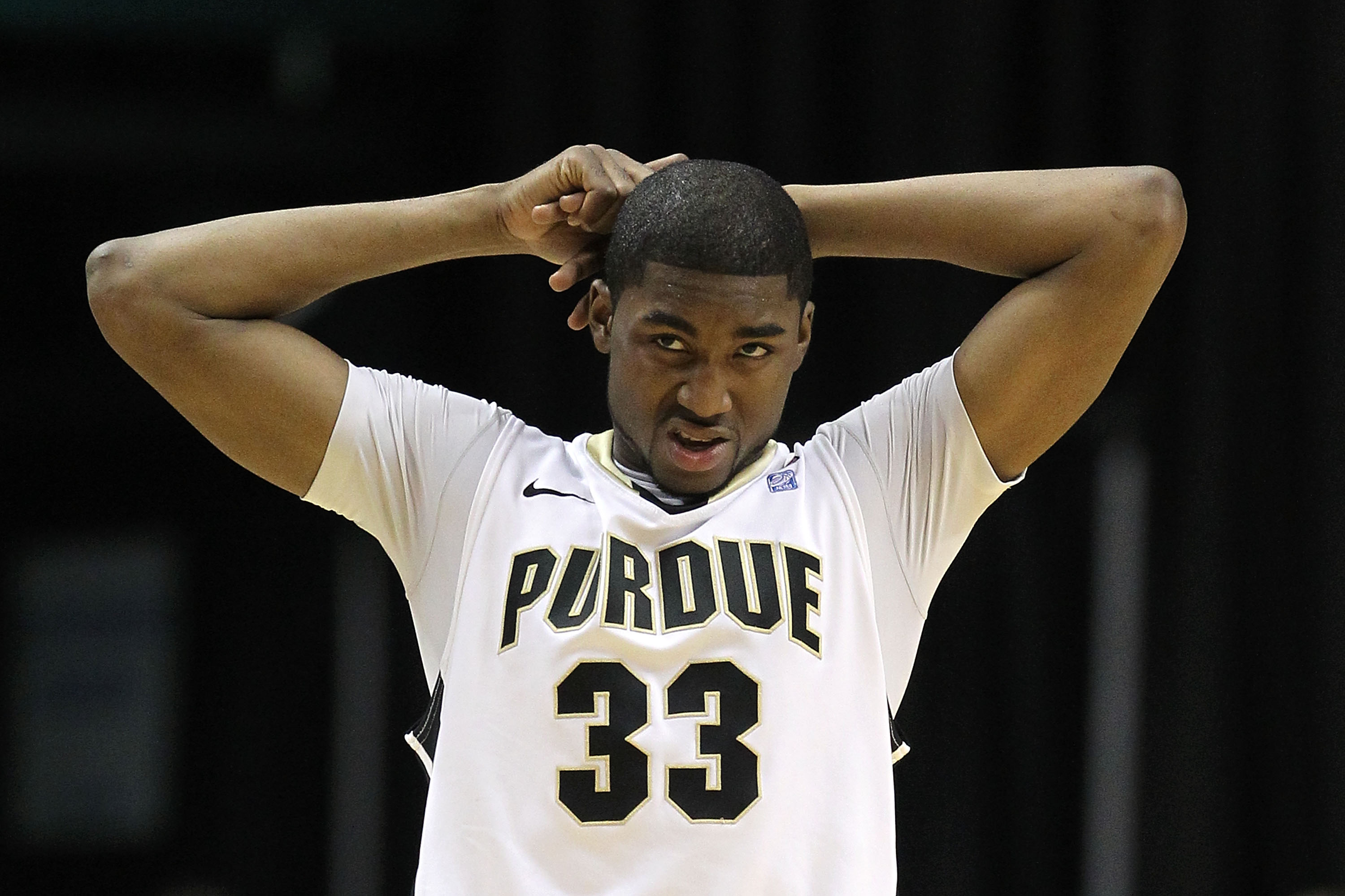 INDIANAPOLIS, IN - MARCH 11:  E'Twaun Moore #33 of the Purdue Boilermakers looks on dejected against the Michigan State Spartans during the quarterfinals of the 2011 Big Ten Men's Basketball Tournament at Conseco Fieldhouse on March 11, 2011 in Indianapol