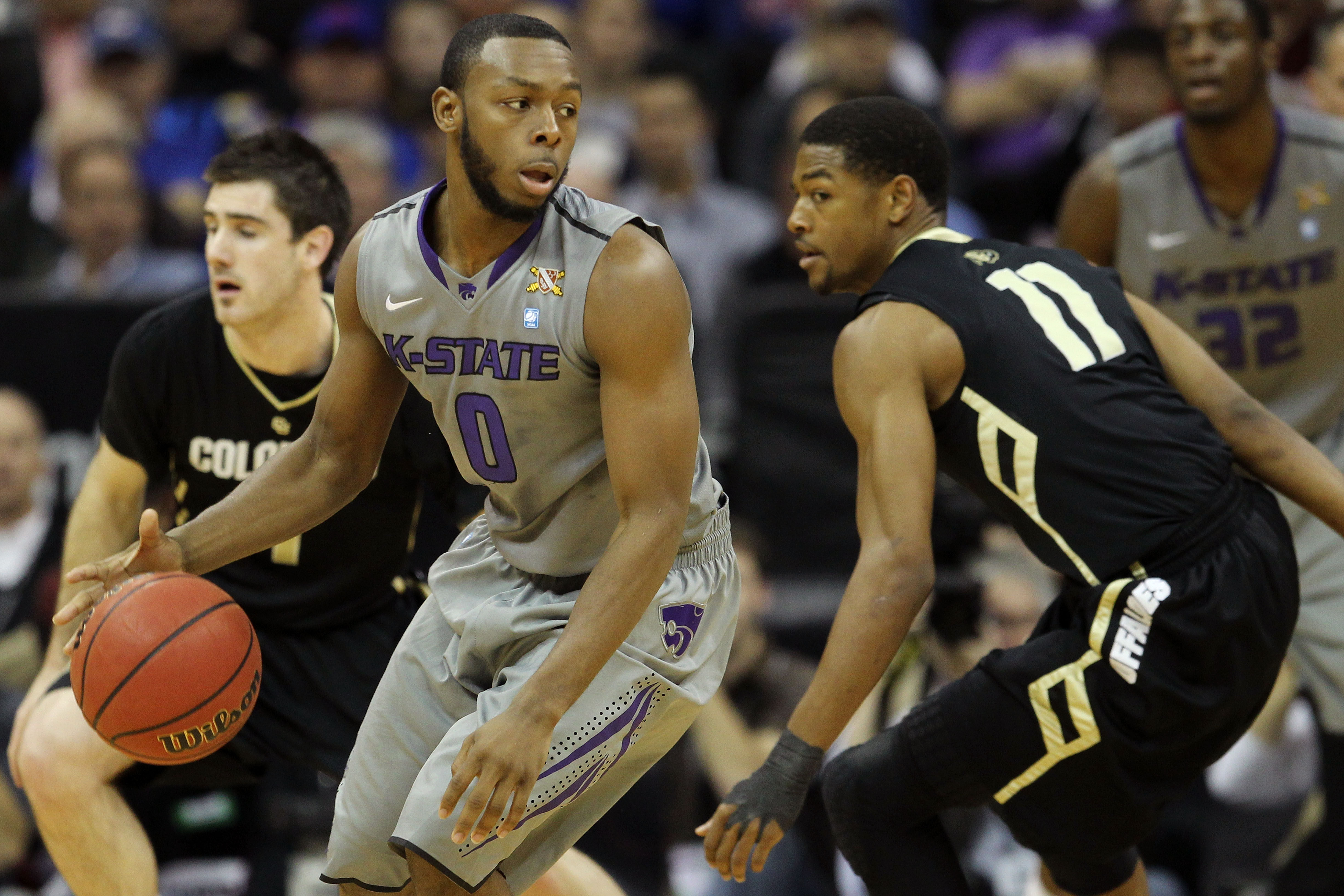 KANSAS CITY, MO - MARCH 10:  Jacob Pullen #0 of the Kansas State Wildcats looks to move the ball against the Colorado Buffaloes during their quarterfinal game in the 2011 Phillips 66 Big 12 Men's Basketball Tournament at Sprint Center on March 10, 2011 in