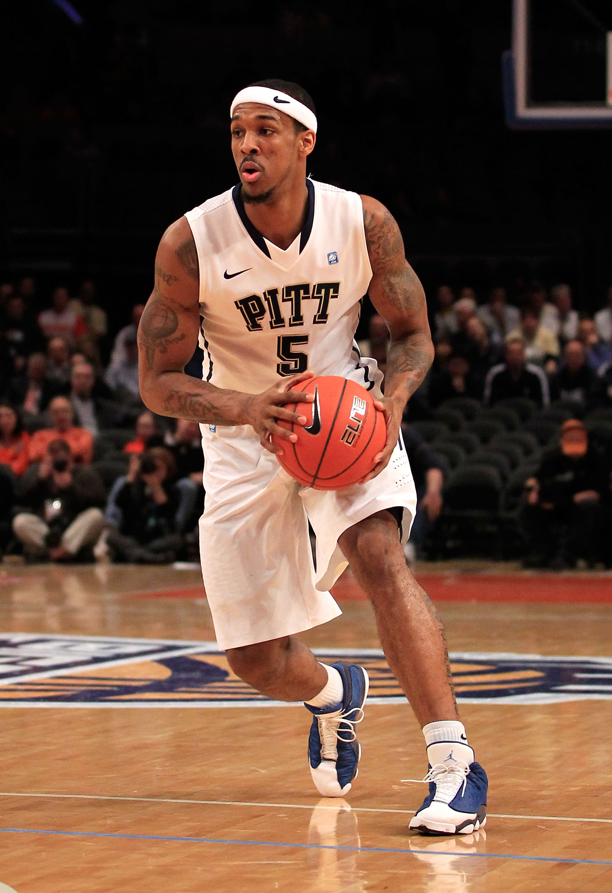 NEW YORK, NY - MARCH 10: Gilbert Brown #5 of the Pittsburgh Panthers brings the ball up court against the Connecticut Huskies during the quarterfinals of the 2011 Big East Men's Basketball Tournament presented by American Eagle Outfitters  at Madison Squa