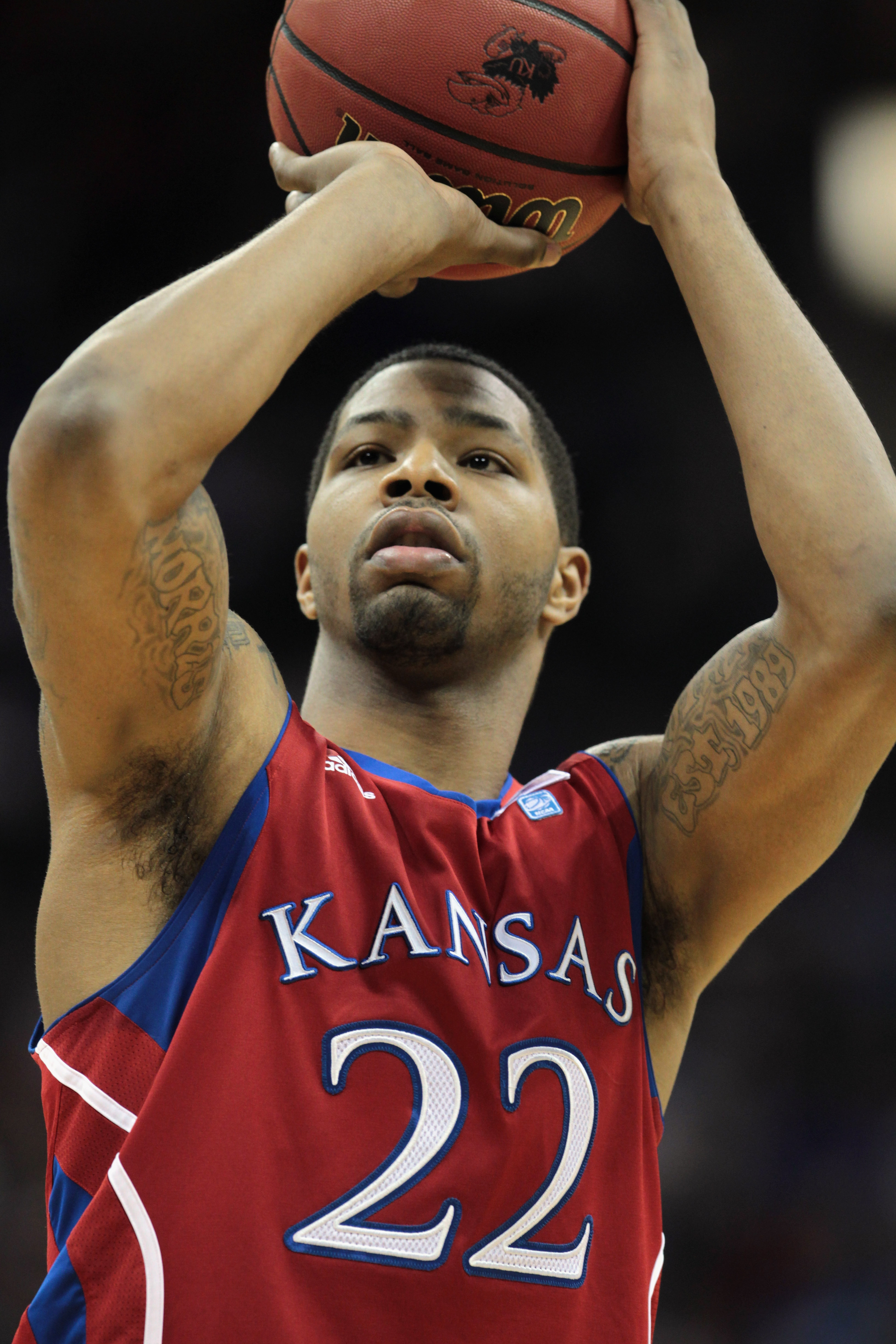 KANSAS CITY, MO - DECEMBER 11:  Marcus Morris #22 of the Kansas Jayhawks in action during the game against the Colorado State Rams on December 11, 2010 at the Sprint Center in Kansas City, Missouri.  (Photo by Jamie Squire/Getty Images)