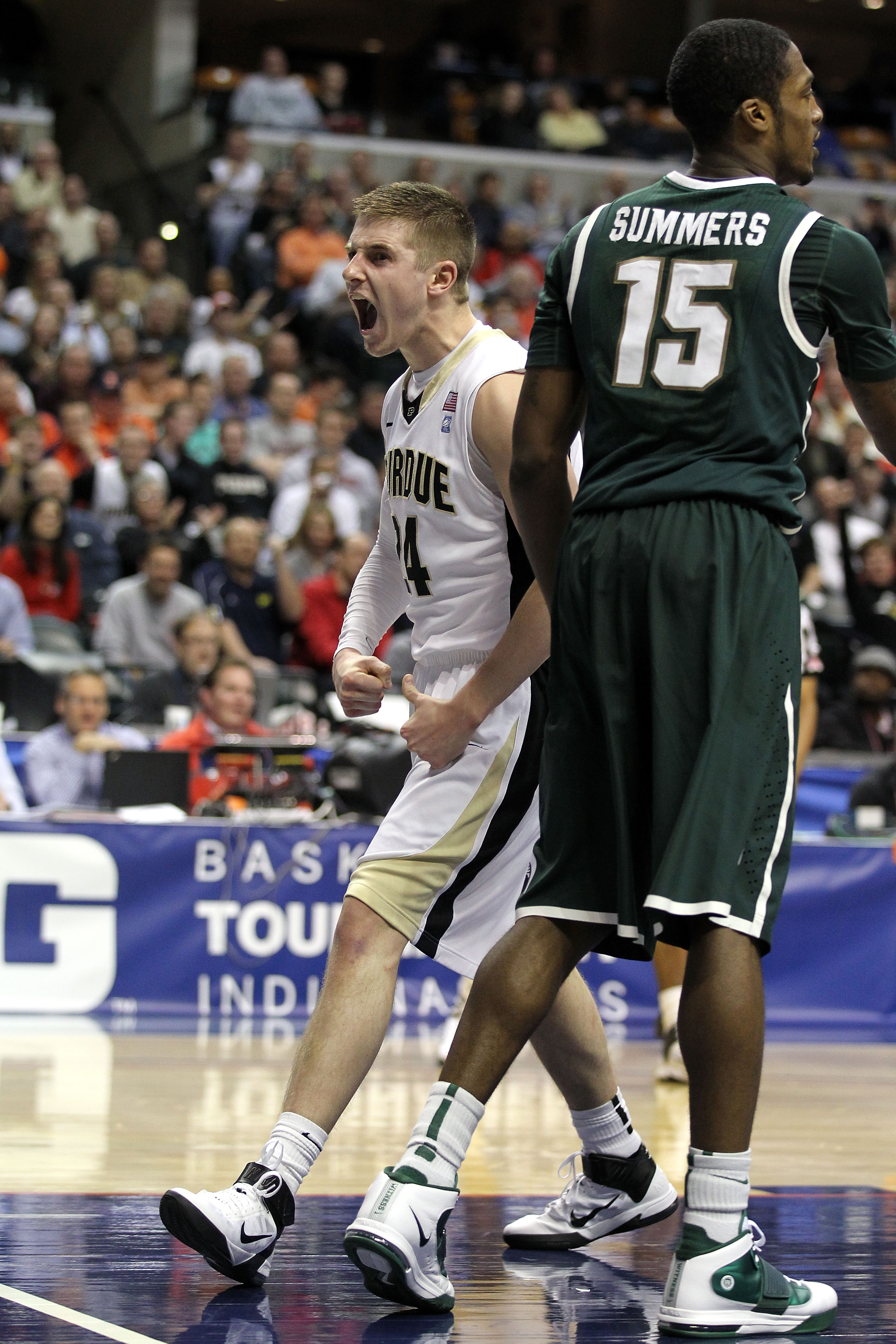 INDIANAPOLIS, IN - MARCH 11:  Ryne Smith #24 of the Purdue Boilermakers reacts against Durrell Summers #15 of the Michigan State Spartans during the quarterfinals of the 2011 Big Ten Men's Basketball Tournament at Conseco Fieldhouse on March 11, 2011 in I