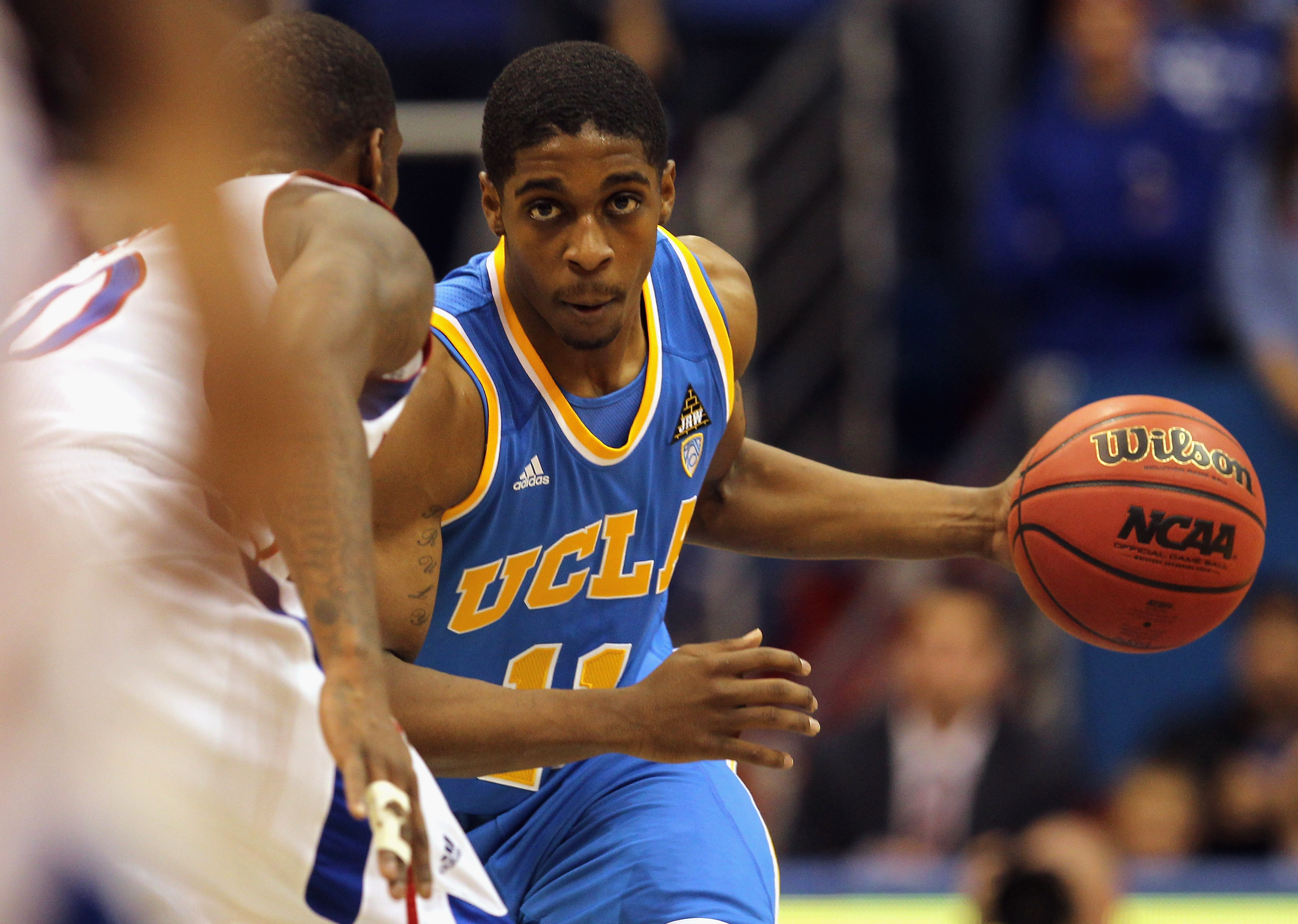 LAWRENCE, KS - DECEMBER 02:  Lazeric Jones #11 of the UCLA Bruins in action during the game against the Kansas Jayhawks on December 2, 2010 at Allen Fieldhouse in Lawrence, Kansas.  (Photo by Jamie Squire/Getty Images)