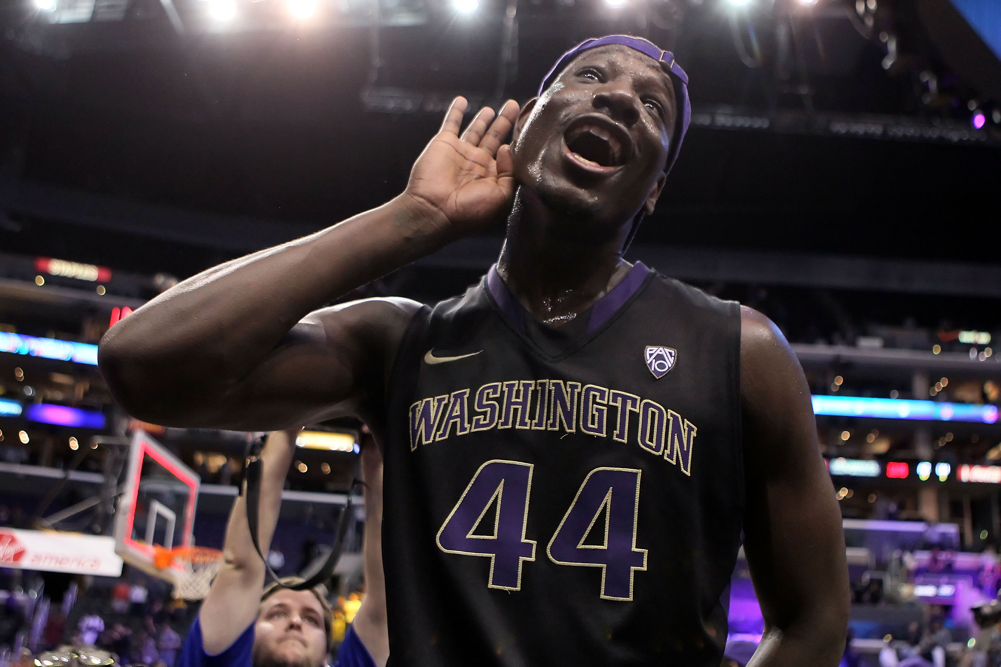 LOS ANGELES, CA - MARCH 12:  Darnell Gant #44 of the Washington Huskies celebrates after defeating the Arizona Wildcats 77-75  in overtime in the championship game of the 2011 Pacific Life Pac-10 Men's Basketball Tournament at Staples Center on March 12,