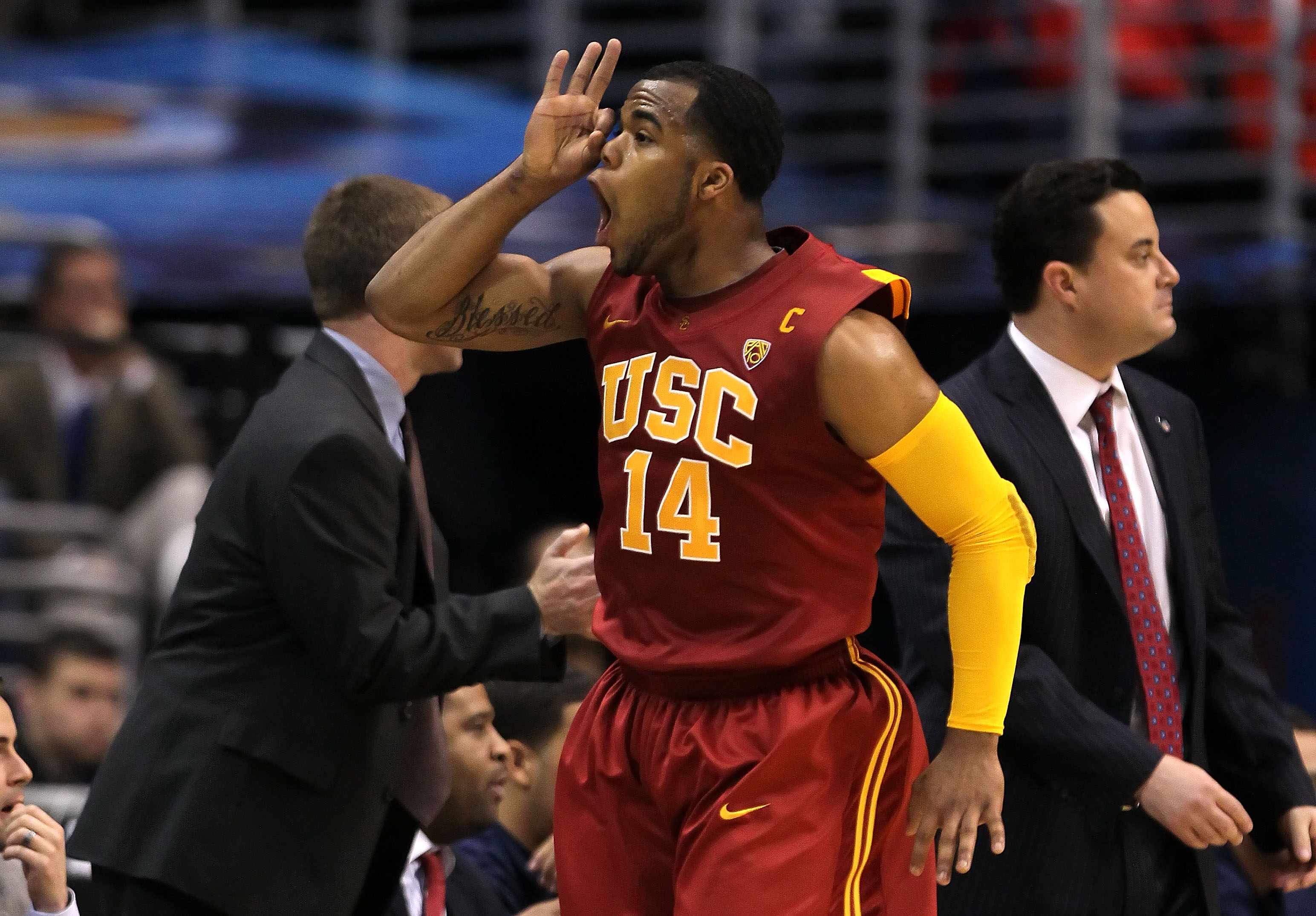 LOS ANGELES, CA - MARCH 11:  Donte Smith #14 of the USC Trojans reacts after making a basket in the first half against the Arizona Wildcats in the semifinals of the 2011 Pacific Life Pac-10 Men's Basketball Tournament at Staples Center on March 11, 2011 i
