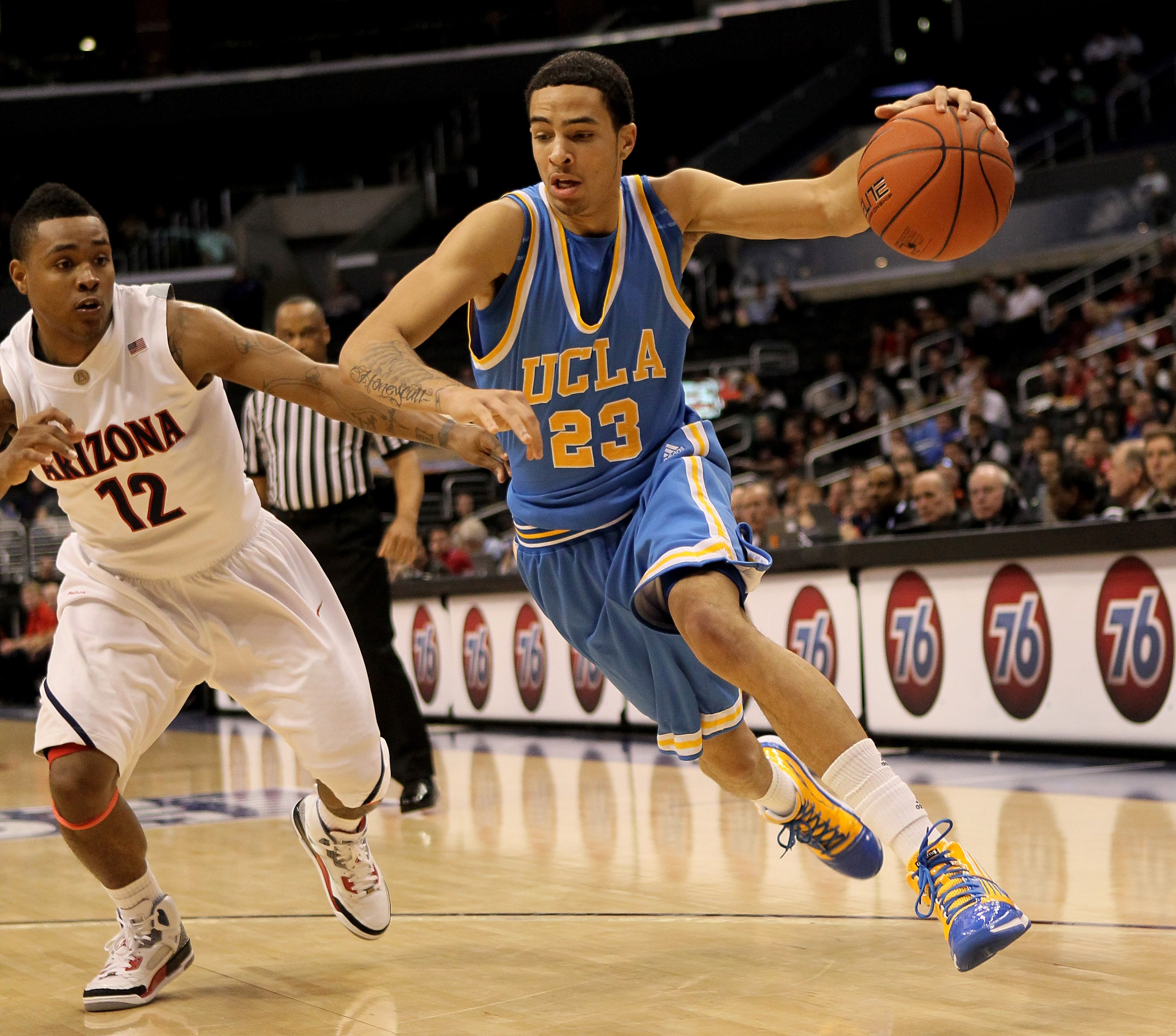 LOS ANGELES, CA - MARCH 11:  Tyler Honeycutt #23 of the UCLA Bruins drives around Lamont Jones #12 of the Arizona Wildcats during the quarterfinals of the Pac-10 Basketball Tournament at Staples Center on March 11, 2010 in Los Angeles, California. UCLA wo