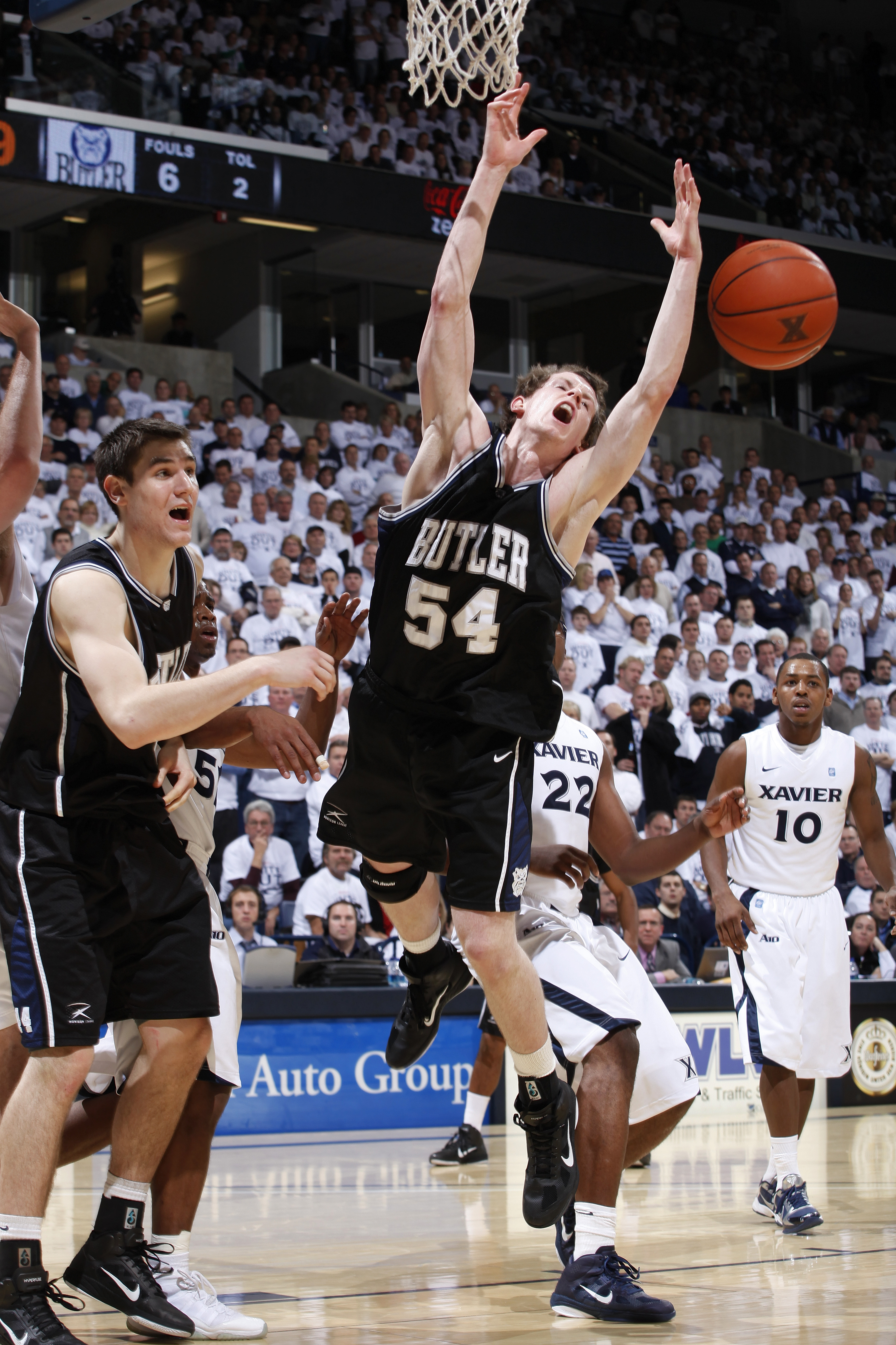 CINCINNATI, OH - DECEMBER 9: Matt Howard #54 of the Butler Bulldogs has the ball knocked away as he goes up for a shot against the Xavier Musketeers at Cintas Center on December 9, 2010 in Cincinnati, Ohio. Xavier defeated Butler 51-49. (Photo by Joe Robb