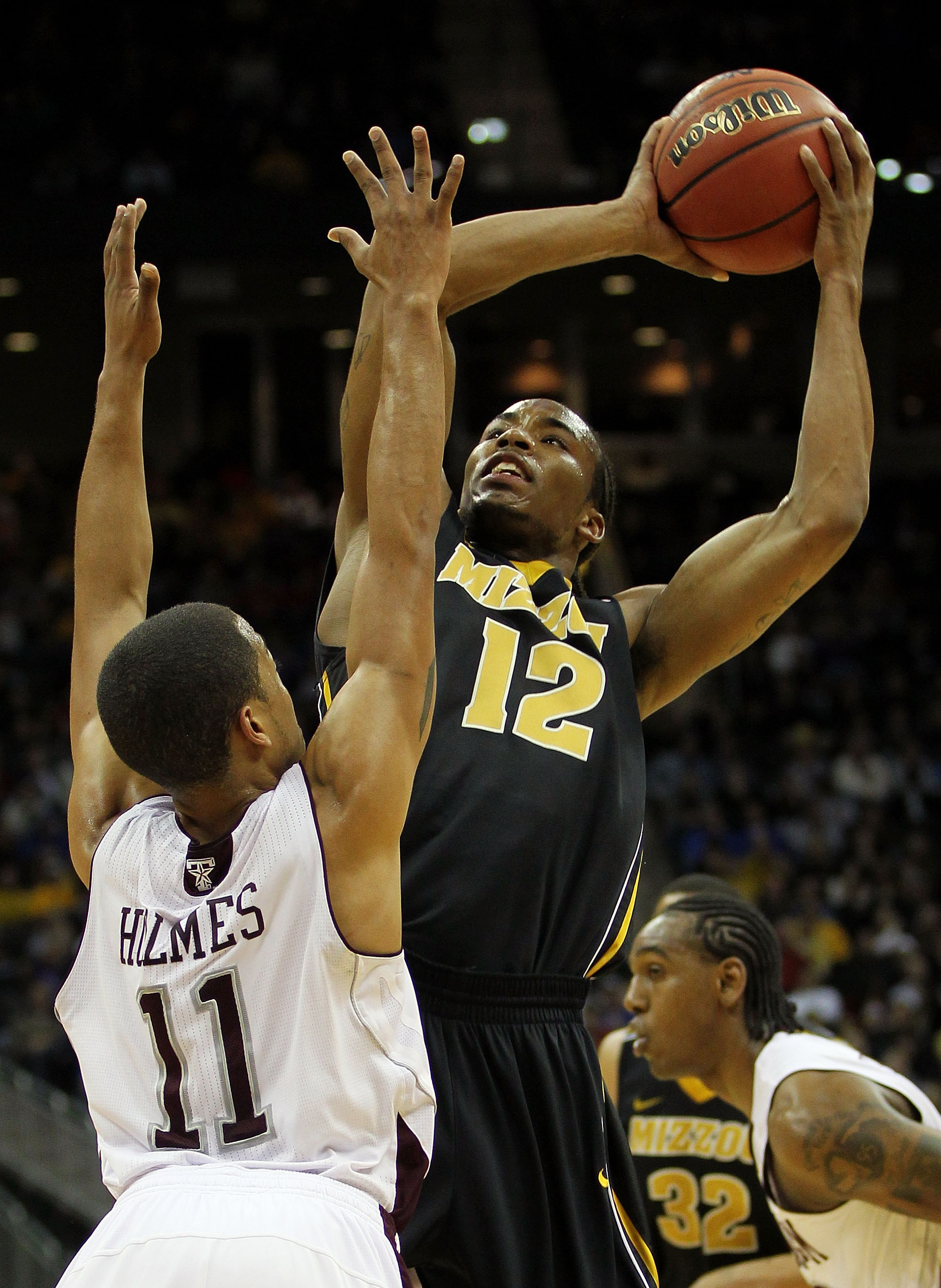 KANSAS CITY, MO - MARCH 10:  Marcus Denmon #12 of the Missouri Tigers goes up for a shot against B.J. Holmes #11 of the Texas A&M Aggies during their quarterfinal game in the 2011 Phillips 66 Big 12 Men's Basketball Tournament at Sprint Center on March 10