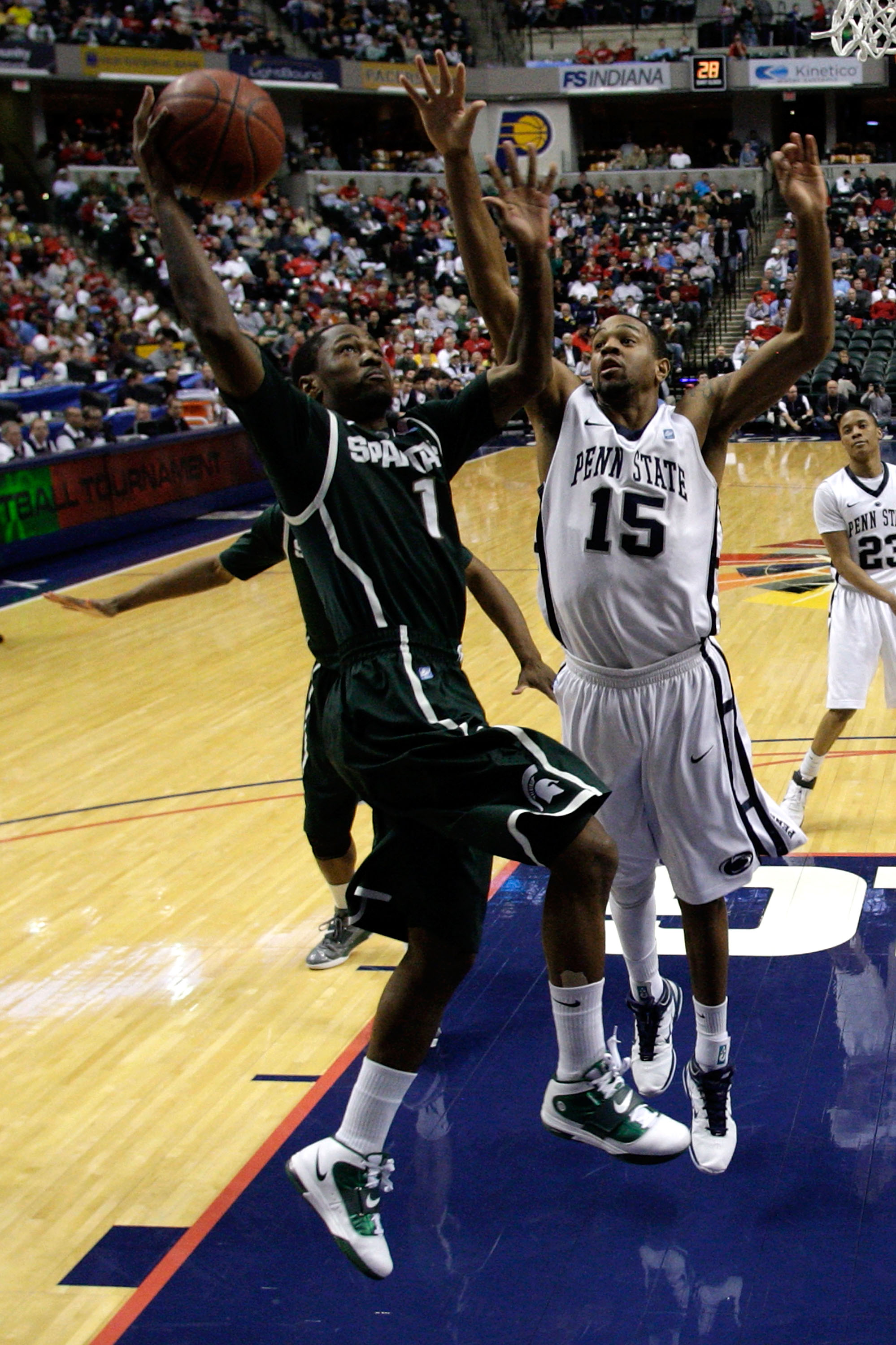 INDIANAPOLIS, IN - MARCH 12:  Kalin Lucas #1 of the Michigan State Spartans drives for a shot attempt against David Jackson #15 of the Penn State Nittany Lions during the semifinals of the 2011 Big Ten Men's Basketball Tournament at Conseco Fieldhouse on