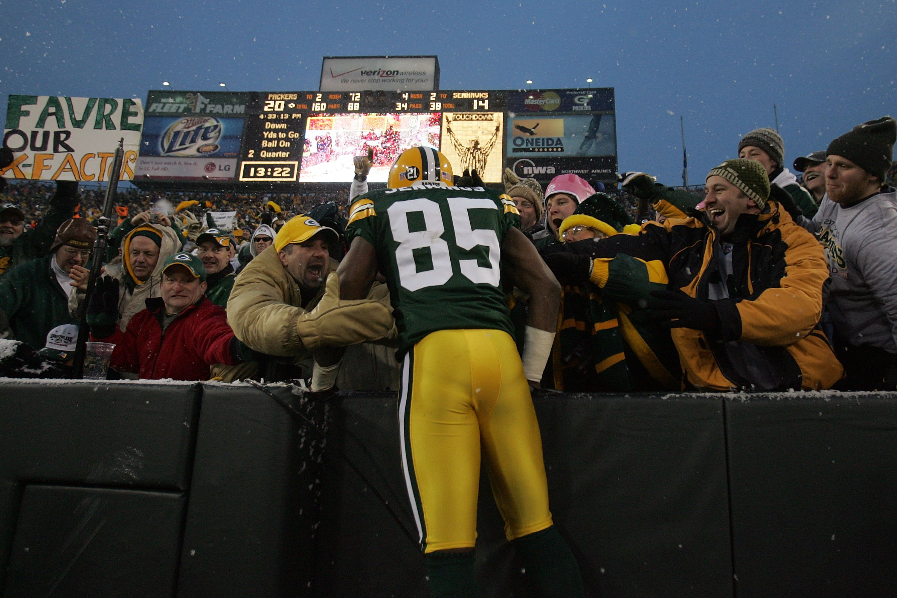 GREEN BAY, WI - JANUARY 12:  Wide receiver Greg Jennings #85 of the Green Bay Packers celebrates with a 'Lambeau leap' after catching a two-yard touchdown pass in the second quarter against the Seattle Seahawks during the NFC divisional playoff game on Ja