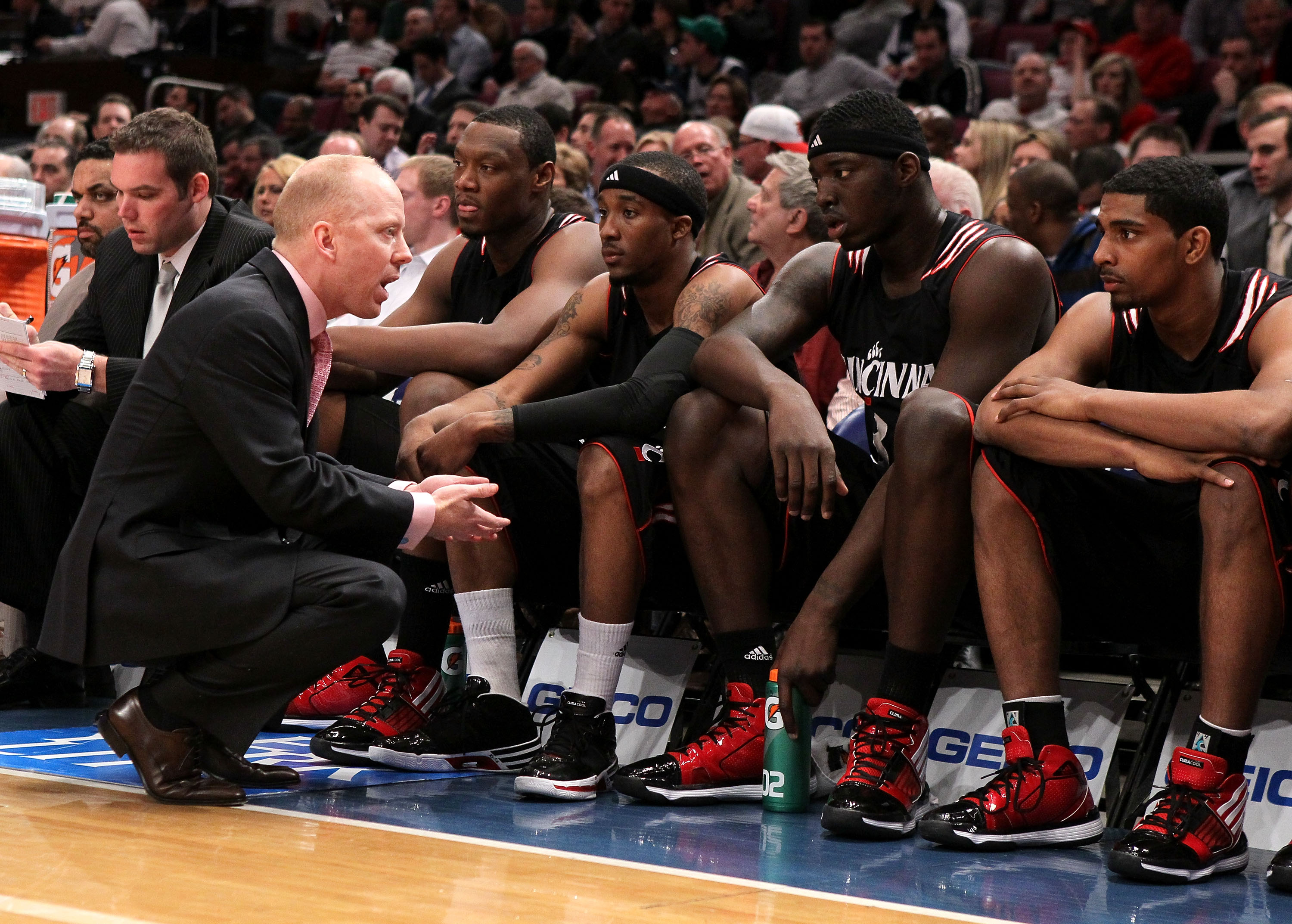 NEW YORK - MARCH 10: Head coach Mick Cronin of the Cincinnati Bearcats talks to his players against the Louisville Cardinals during the second round of 2010 NCAA Big East Tournament at Madison Square Garden on March 10, 2010 in New York City.  (Photo by J