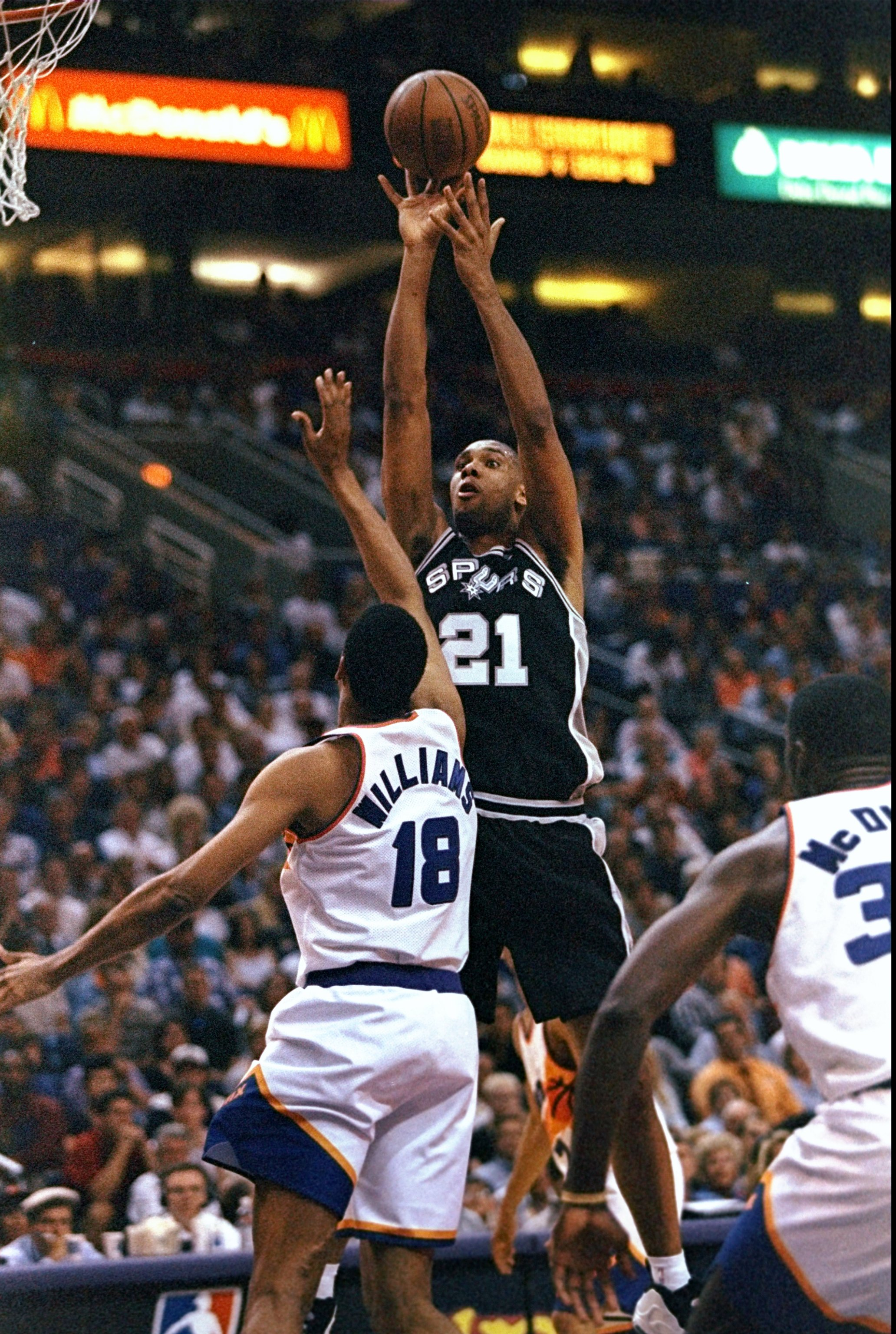 23 Apr 1998:  Tim Duncan #21 of the San Antonio Spurs shoots the ball over a player from the Phoenix Suns during a first round playoff game at the America West Arena in Phoenix, Arizona. The Spurs defeated the Suns 102-96. Mandatory Credit: Tom Hauck  /Al