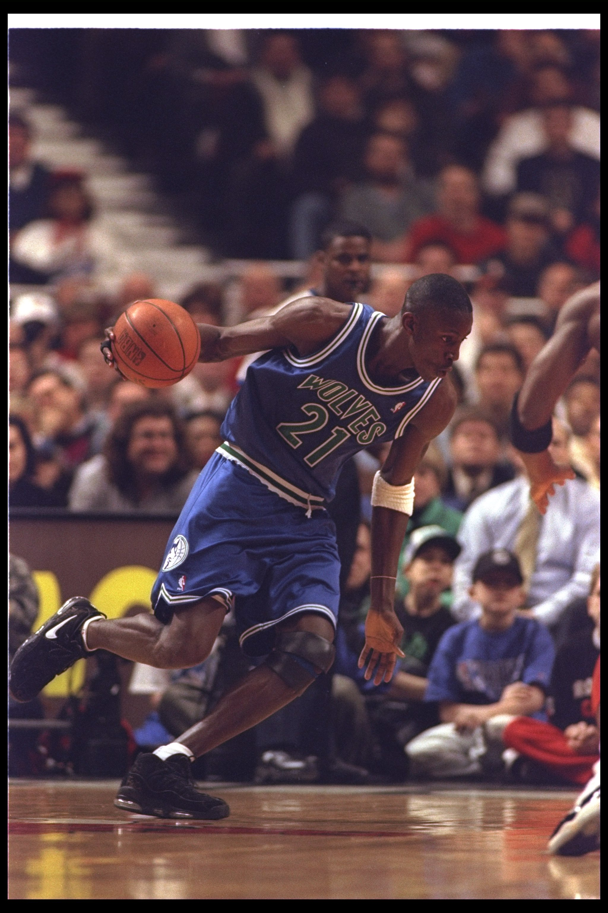 27 Feb 1996: Forward Kevin Garnett of the Minnesota Timberwolves moves the ball during a game against the Chicago Bulls at the United Center in Chicago, Illinois. The Bulls won the game, 120-99.
