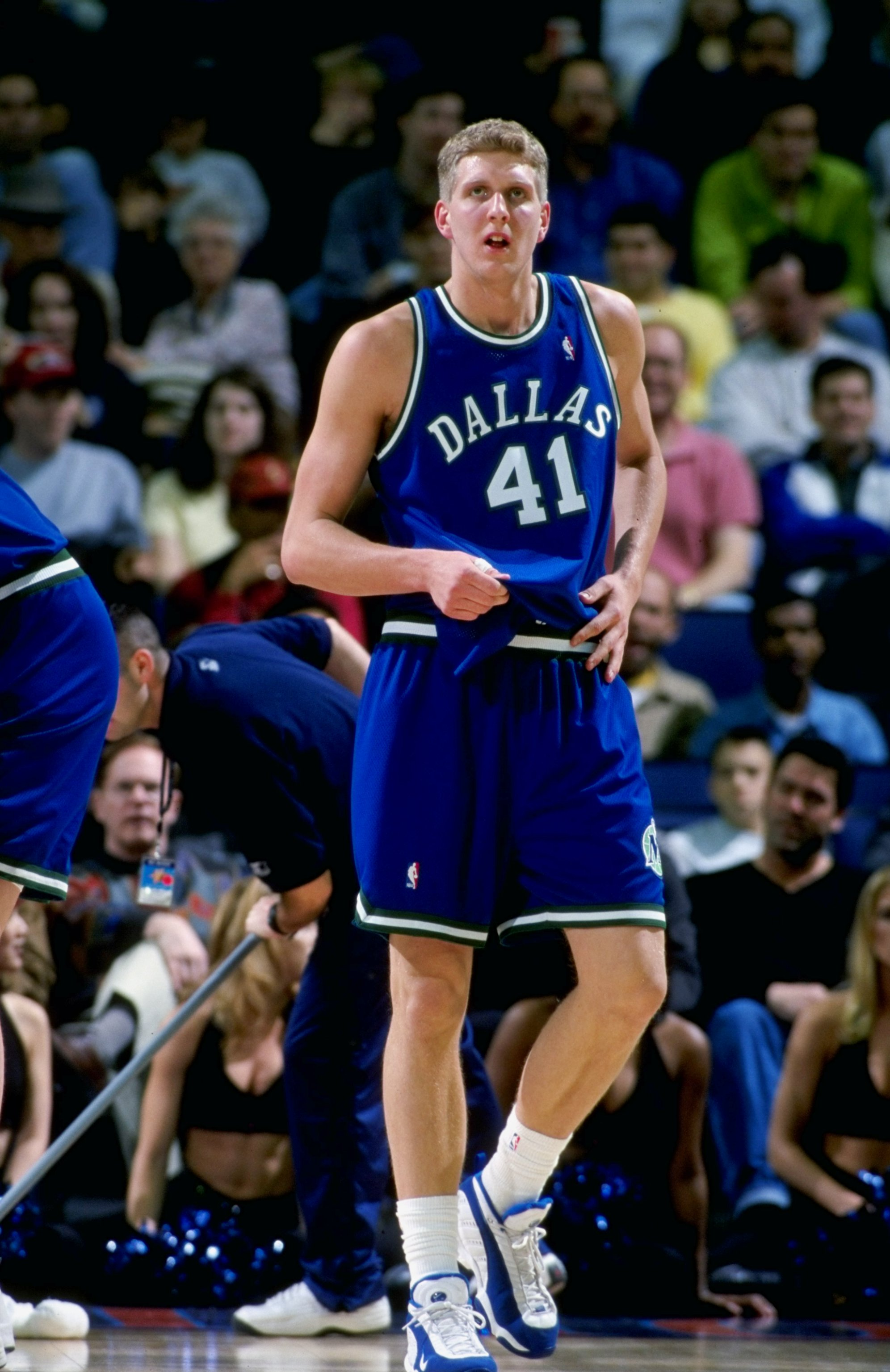 19 Feb 1999:  Dirk Nowitzki #41 of the Dallas Mavericks walks on the court during the game against the Golden State Warriors at the Oakland Coliseum in Oakland, California. The Warriors defeated the Mavericks 84-79.  Mandatory Credit: Jed Jacobsohn  /Alls