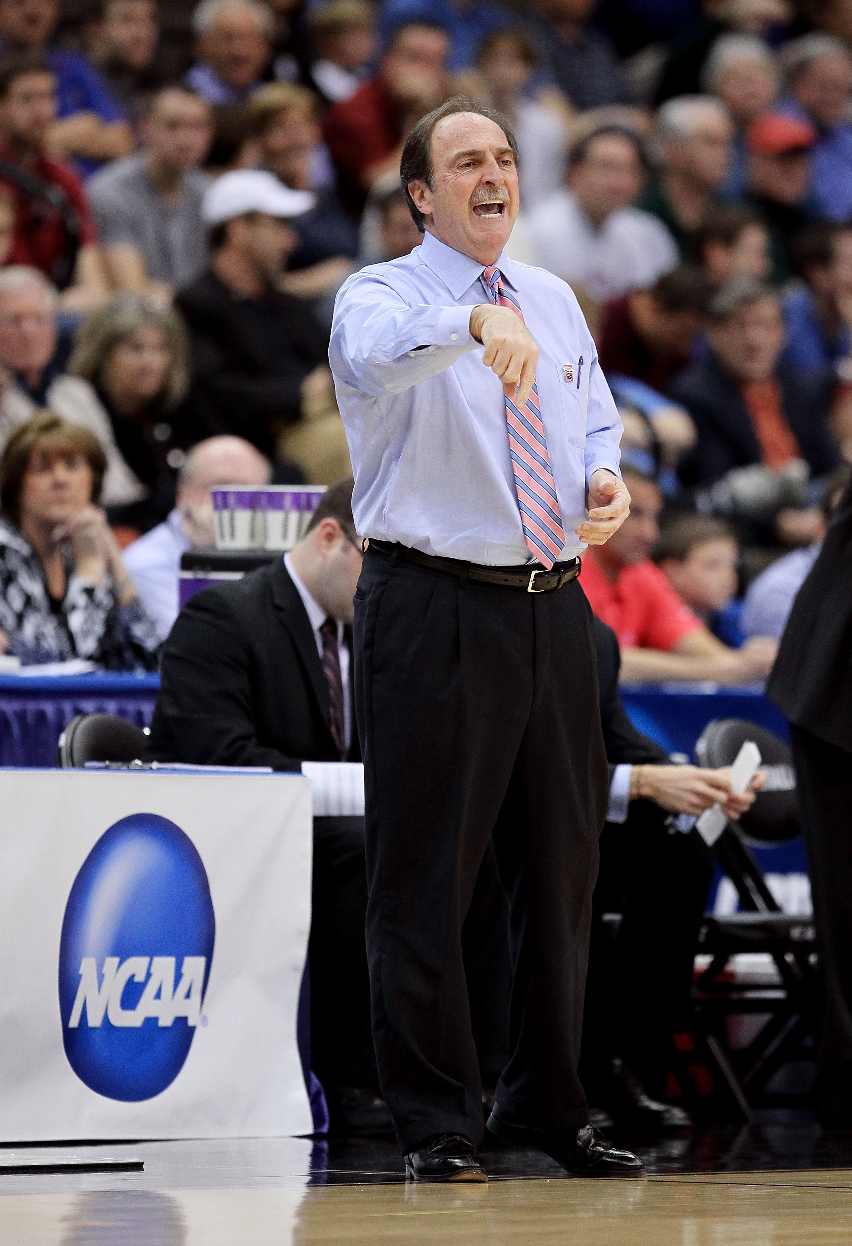 JACKSONVILLE, FL - MARCH 19:  Head coach Fran Dunphy of the Temple Owls calls out a play while taking on the Cornell Big Red during the first round of the 2010 NCAA men's basketball tournament at Jacksonville Veteran's Memorial Arena on March 19, 2010 in