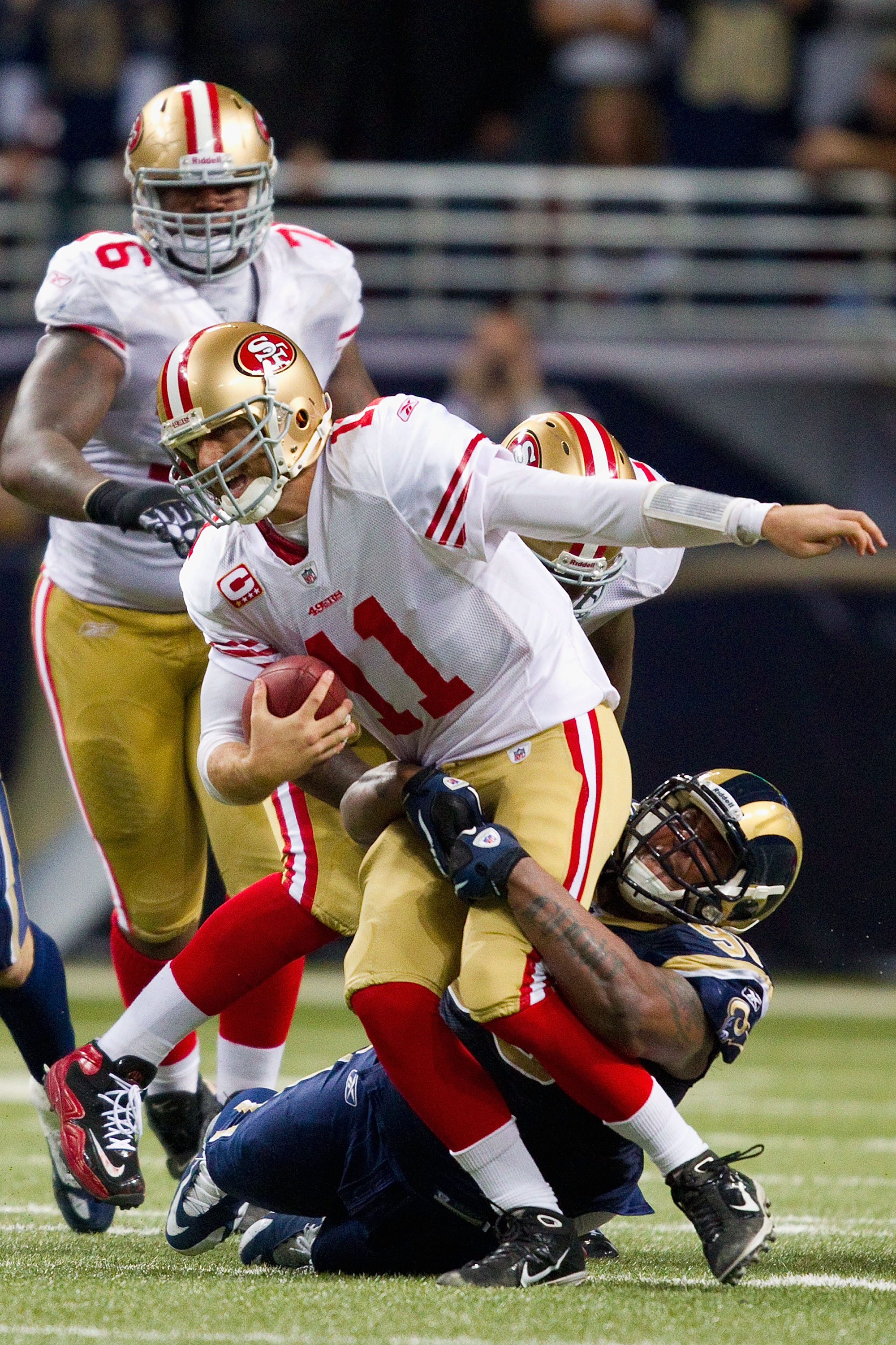 ST. LOUIS, MO - DECEMBER 26: Fred Robbins #98 of the St. Louis Rams sacks Alex Smith #11 of the San Francisco 49ers at the Edward Jones Dome on December 26, 2010 in St. Louis, Missouri. The Rams beat the 49ers 25-17. (Photo by Dilip Vishwanat/Getty Images