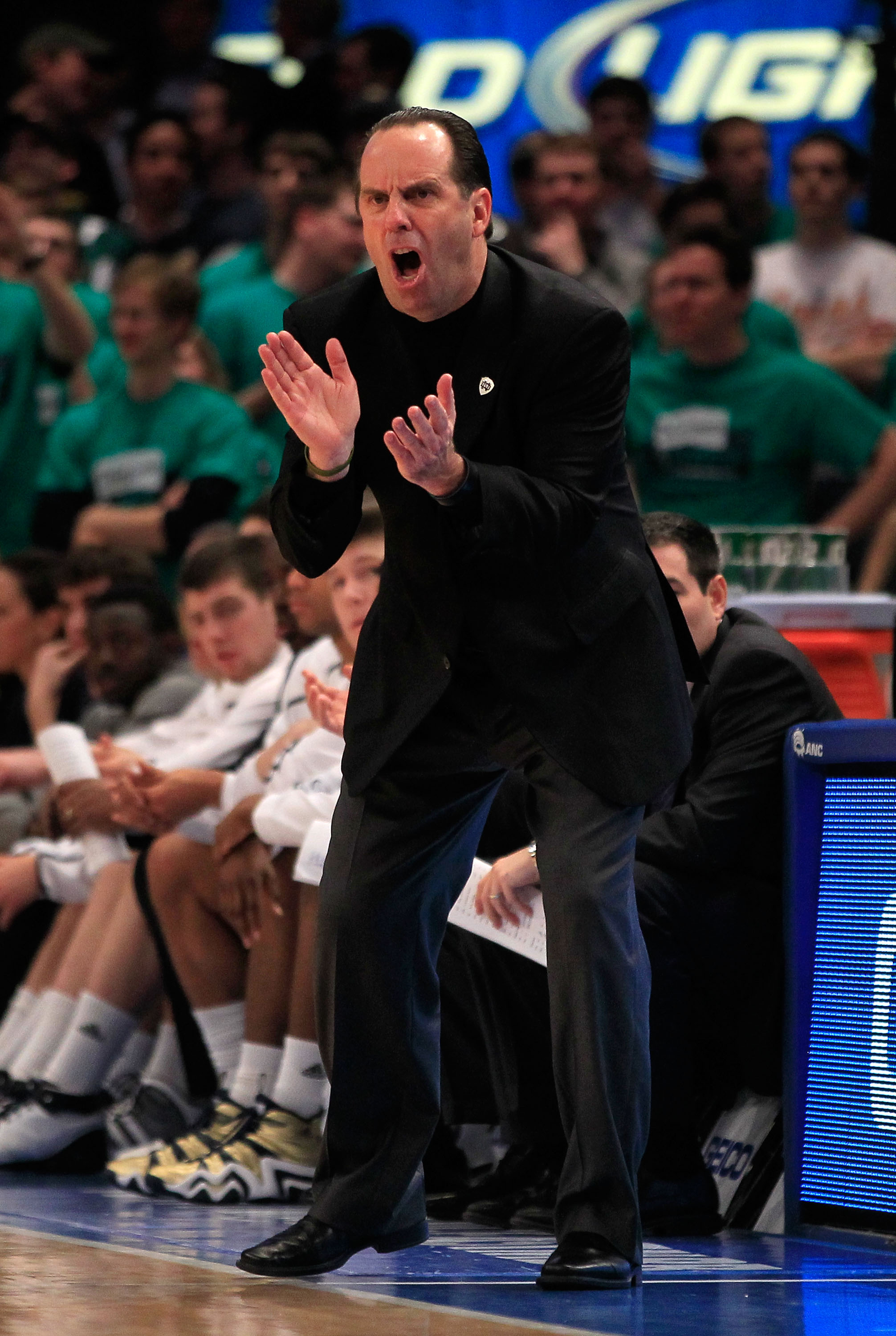 NEW YORK, NY - MARCH 10: Head coach Mike Brey of the Notre Dame Fighting Irish claps while looking on from the bench against the Cincinnati Bearcats during the quarterfinals of the 2011 Big East Men's Basketball Tournament presented by American Eagle Outf